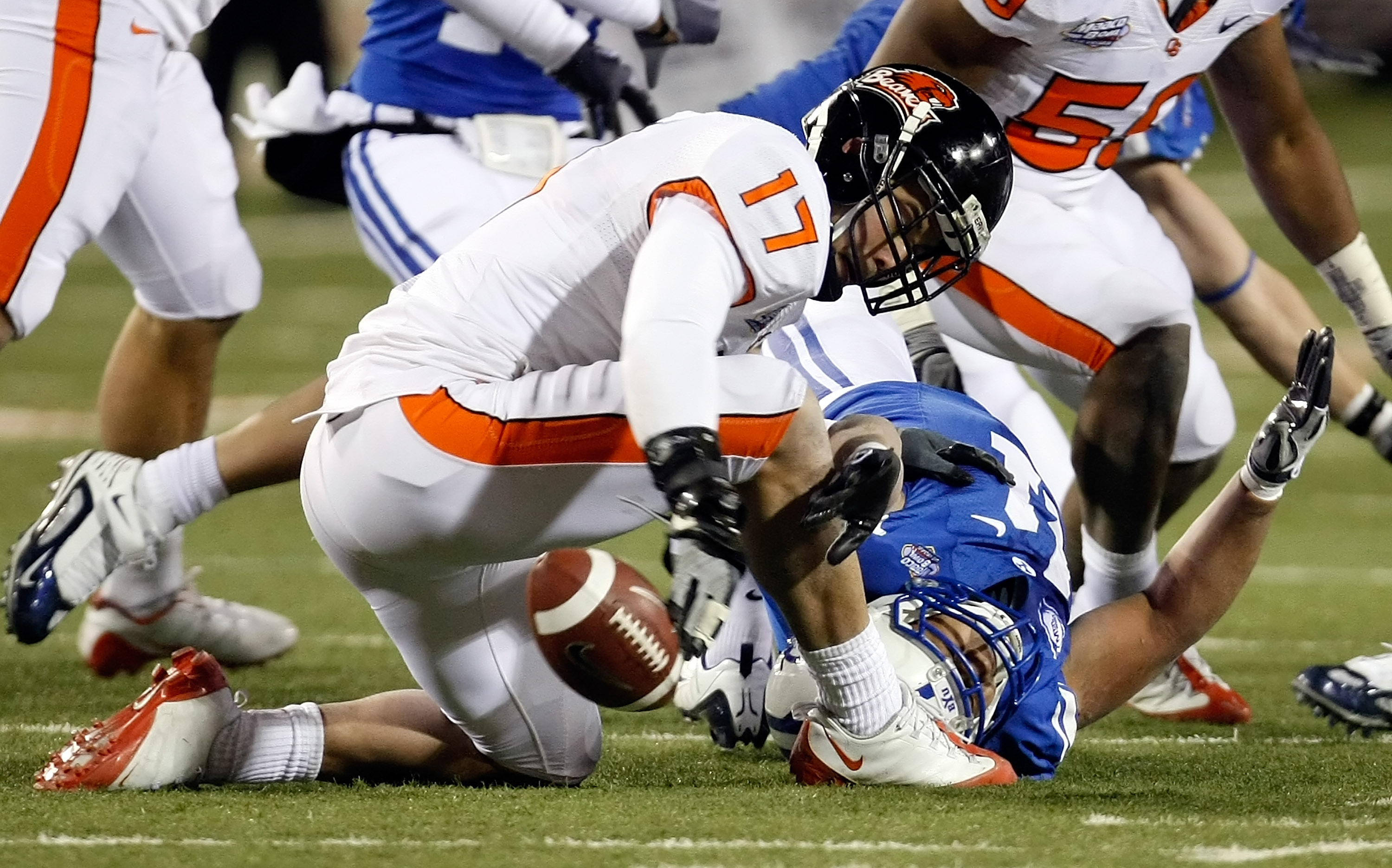 LAS VEGAS - DECEMBER 22:  Brandon Hardin #17 of the Oregon State Beavers tries to recover the ball after Manase Tonga #11 of the Brigham Young University Cougars dropped it during an onside kick by the Beavers during the fourth quarter of the MAACO Las Ve