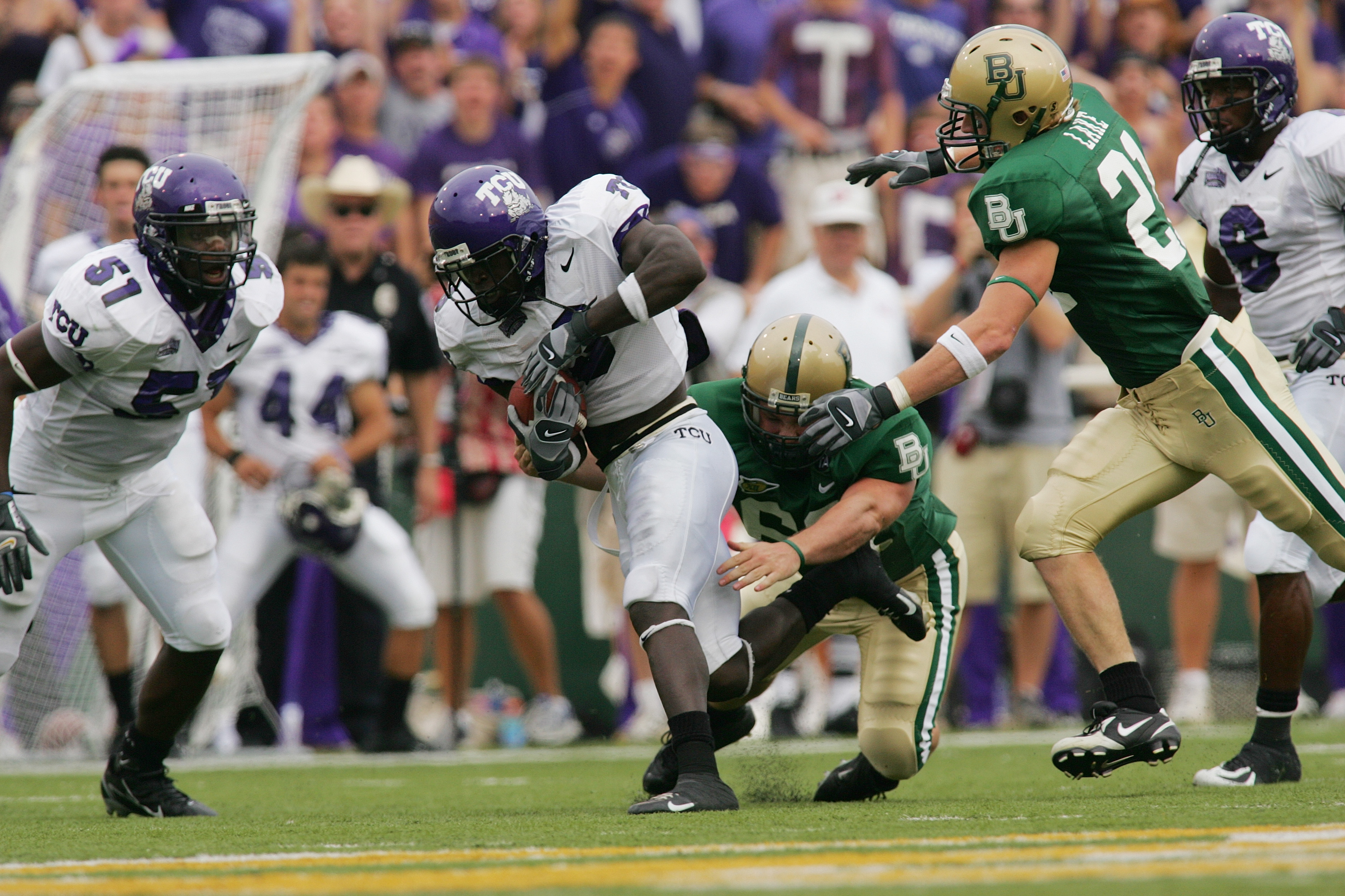 WACO, TX - SEPTEMBER 3:  Wide receiver Marcus Brock #3 of the TCU Horned Frogs runs with the ball during the game against the Baylor Bears on September 3, 2006 at Floyd Casey Stadium in Waco, Texas. TCU defeated Baylor 17-7.  (Photo by Ronald Martinez/Get
