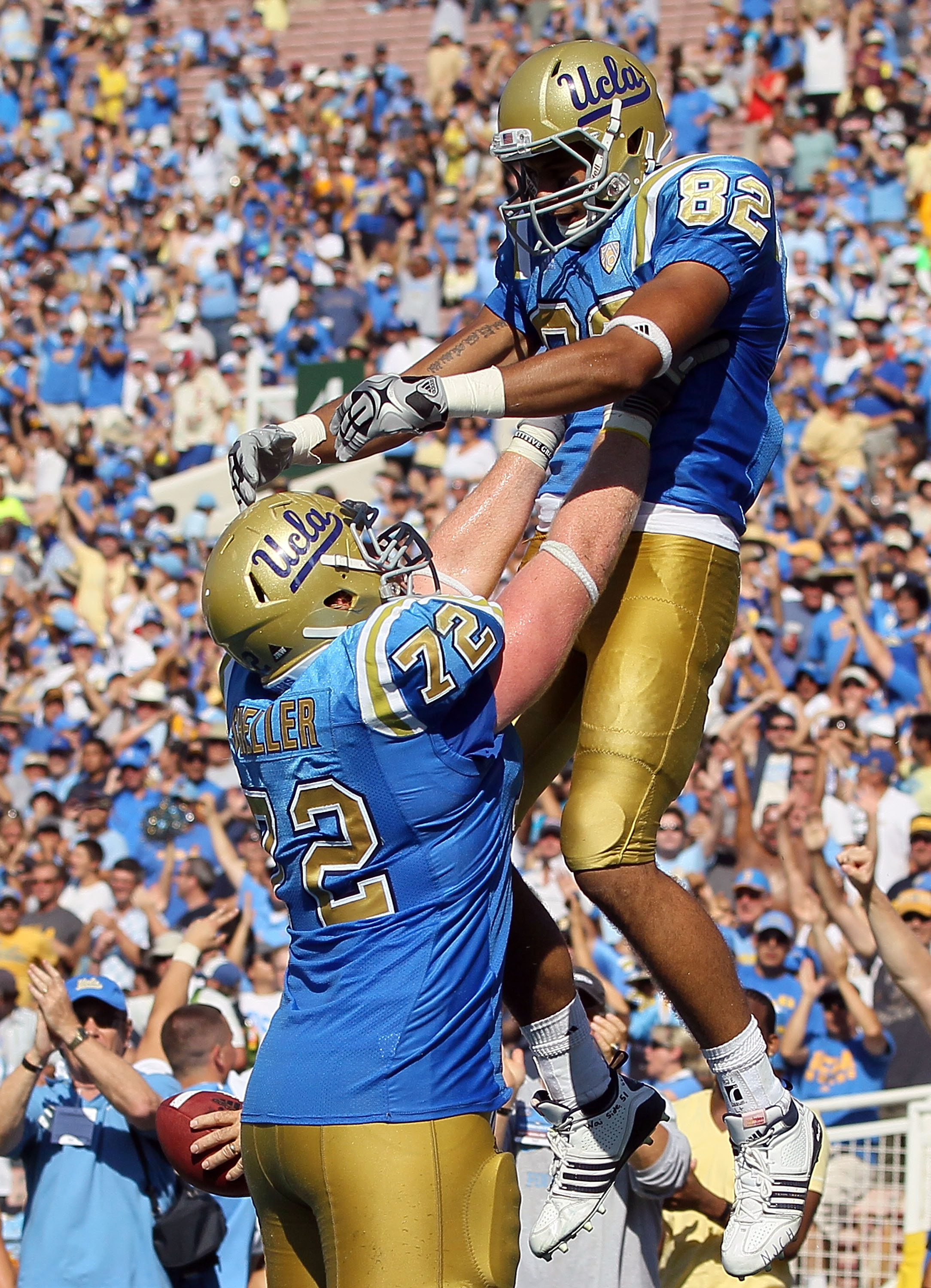 PASADENA, CA - OCTOBER 02:  Taylor Embree #82 and Sean Sheller #72 of the UCLA Bruins celebrate a touchdown against the Washington State Cougars during the game at the Rose Bowl on October 2, 2010 in Pasadena, California. UCLA defeated Washington State 42
