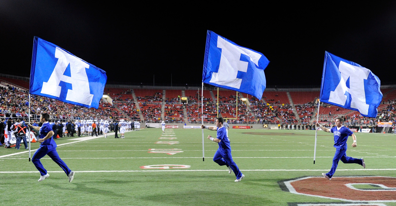 LAS VEGAS - NOVEMBER 18:  Air Force Falcons cheerleaders run flags through the end zone after an Air Force touchdown against the UNLV Rebels at Sam Boyd Stadium November 18, 2010 in Las Vegas, Nevada. Air Force won 35-20.  (Photo by Ethan Miller/Getty Ima