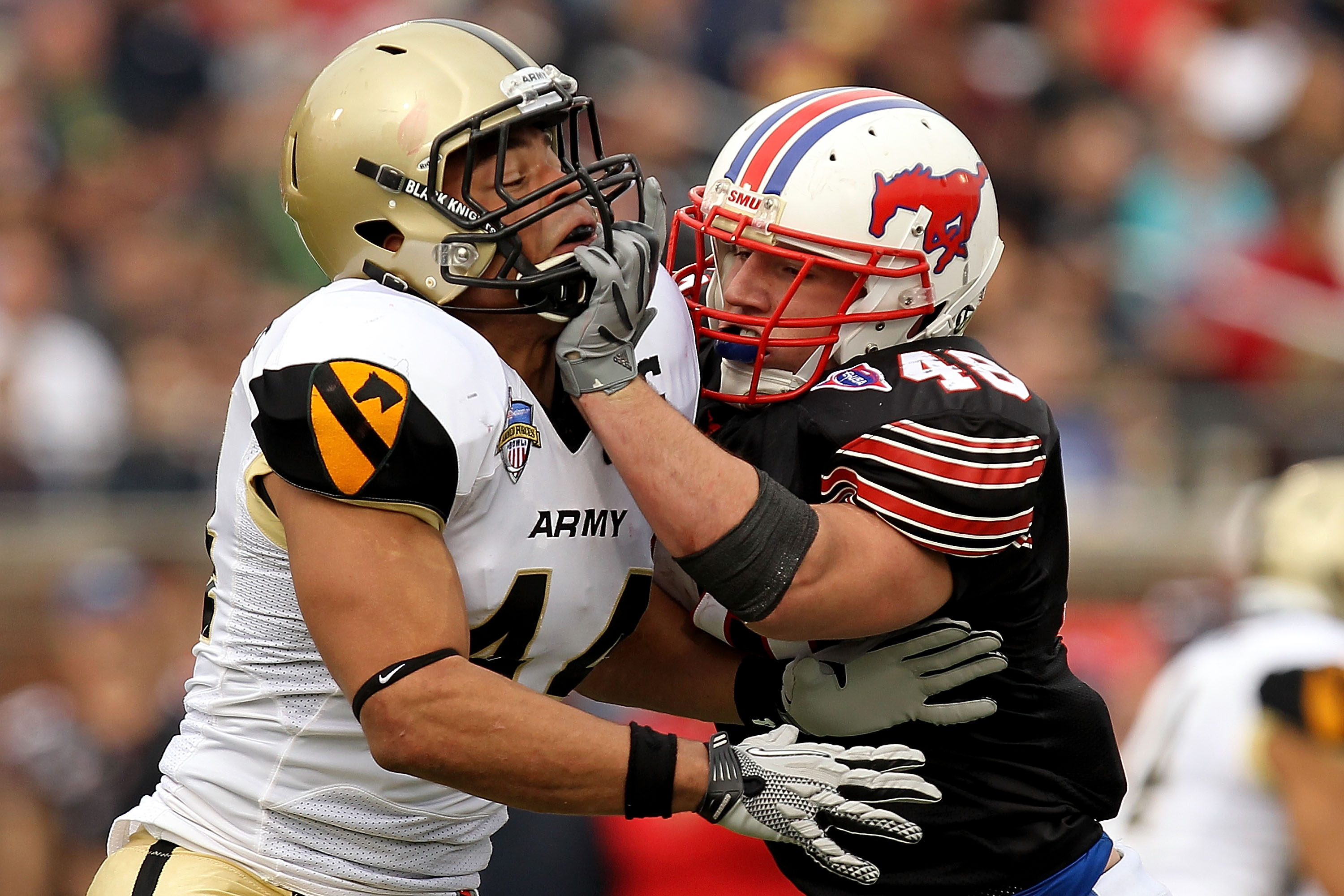 DALLAS, TX - DECEMBER 30:  Defensive end Joshua McNary #44 of the Army Black Knights defends the play against Zach Line #48 of the SMU Mustangs during the Bell Helicopter Armed Forces Bowl at Gerald J. Ford Stadium on December 30, 2010 in Dallas, Texas.
