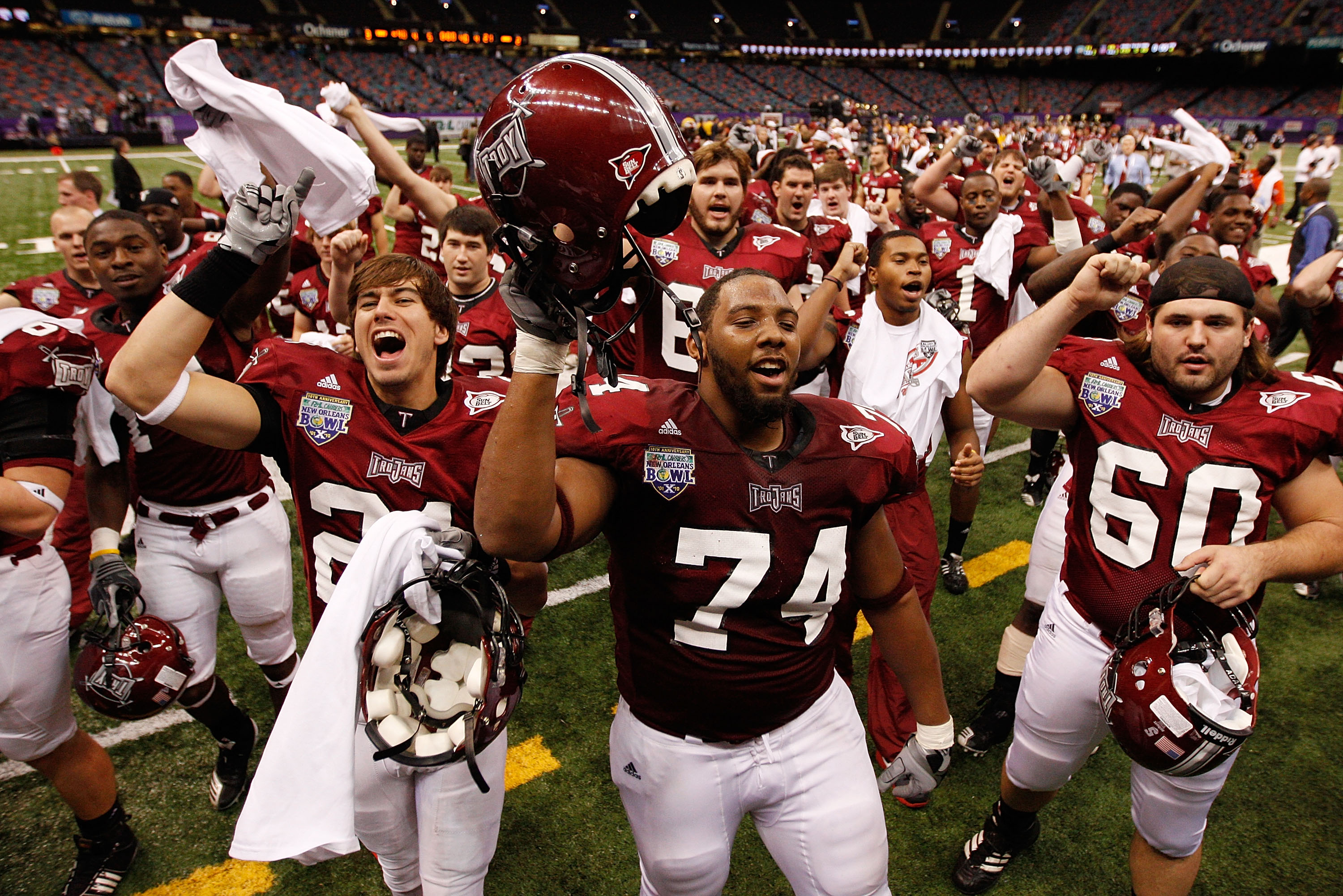 NEW ORLEANS, LA - DECEMBER 18:  Members of the Troy University Trojans celebrate after defeating the Ohio University Bobcats 48-21 during the R&L Carriers New Orleans Bowl at the Louisiana Superdome on December 18, 2010 in New Orleans, Louisiana.  (Photo