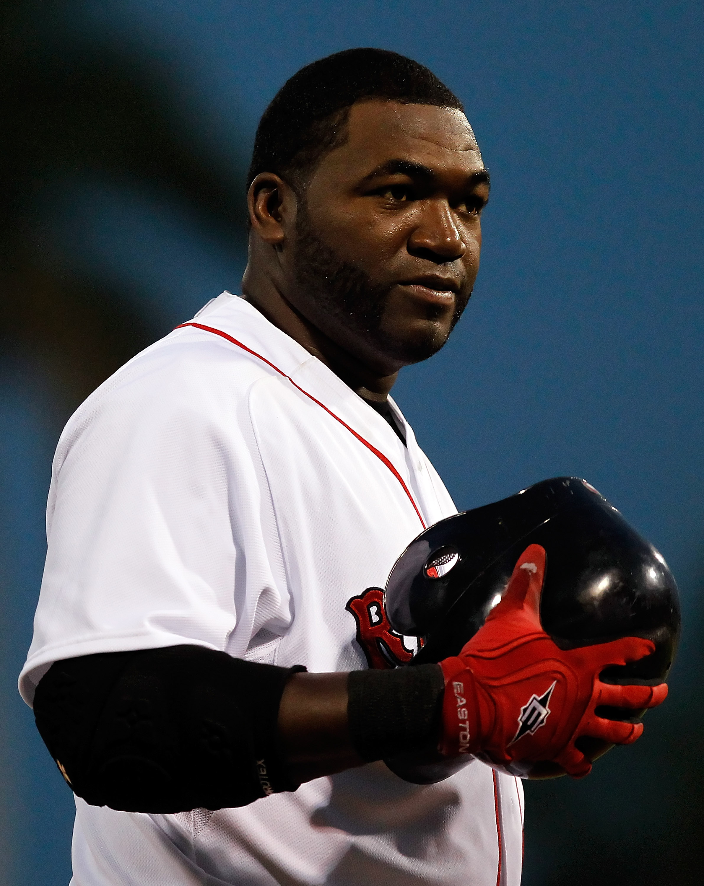 FORT MYERS, FL - MARCH 14:  Designated hitter David Ortiz #34 of the Boston Red Sox smiles after an inning against the New York Yankees during a Grapefruit League Spring Training Game at City of Palms Park on March 14, 2011 in Fort Myers, Florida.  (Photo