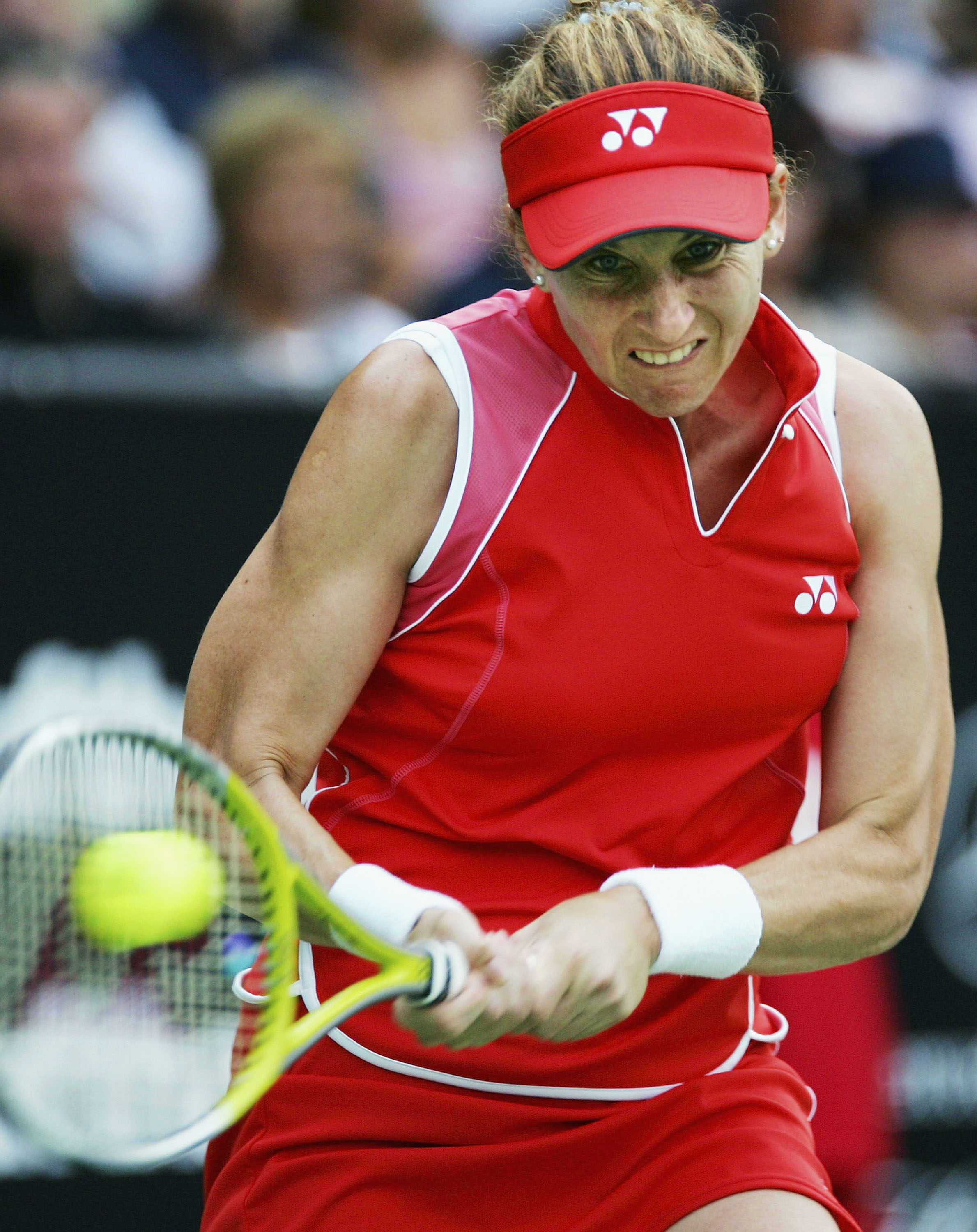 AUCKLAND, NEW ZEALAND - FEBRUARY 1:  Monica Seles hits a return during her exhibition match against Martina Navratilova at the ASB Tennis Centre in Auckland February 1, 2005 in Auckland, New Zealand. Navratilova won the match 6-4, 6-4.  (Photo by Dean Tre