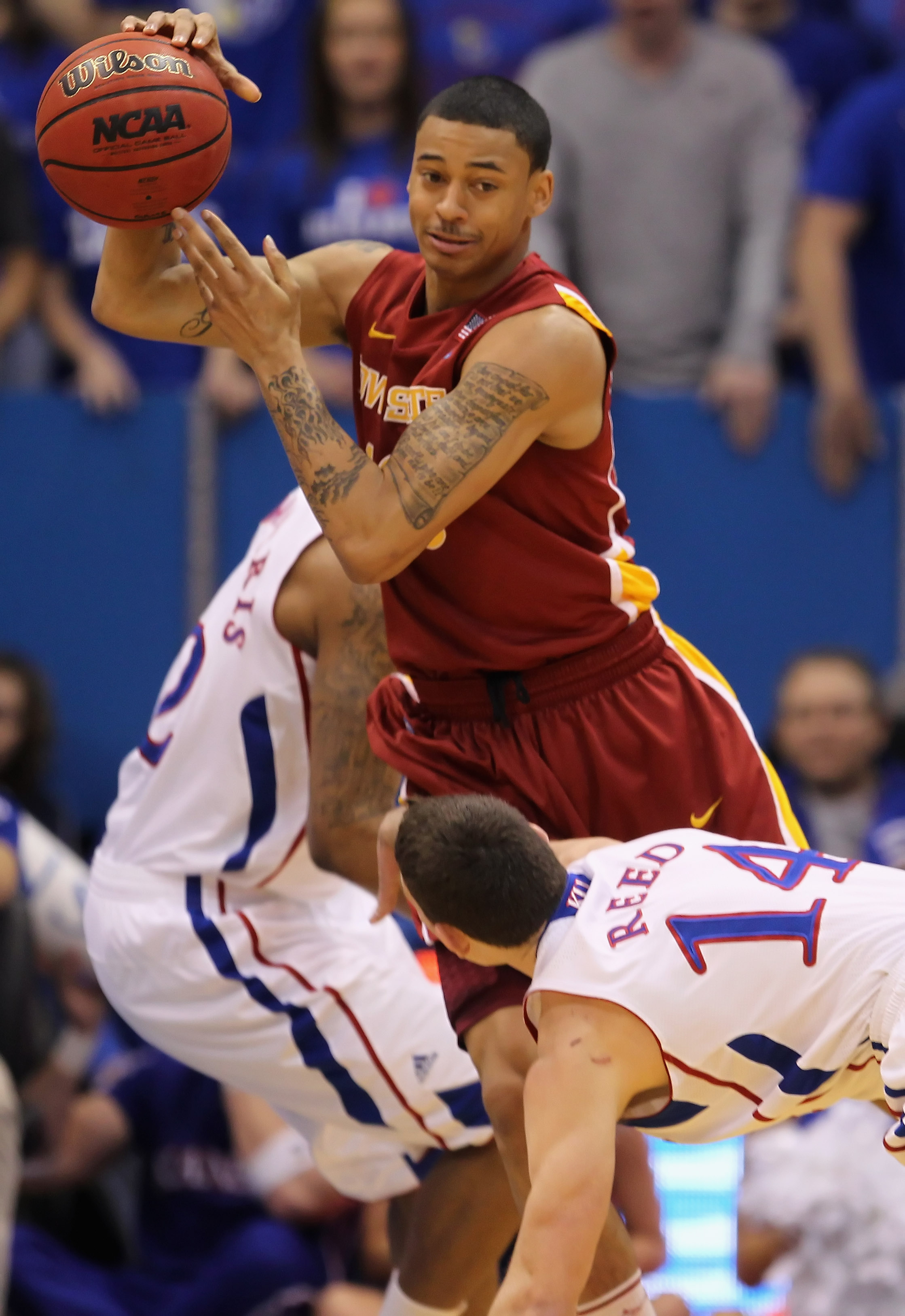 LAWRENCE, KS - FEBRUARY 12:  Diante Garrett #10 of the Iowa State Cyclones passes during the game against the Kansas Jayhawks on February 12, 2011 at Allen Fieldhouse in Lawrence, Kansas.  (Photo by Jamie Squire/Getty Images)
