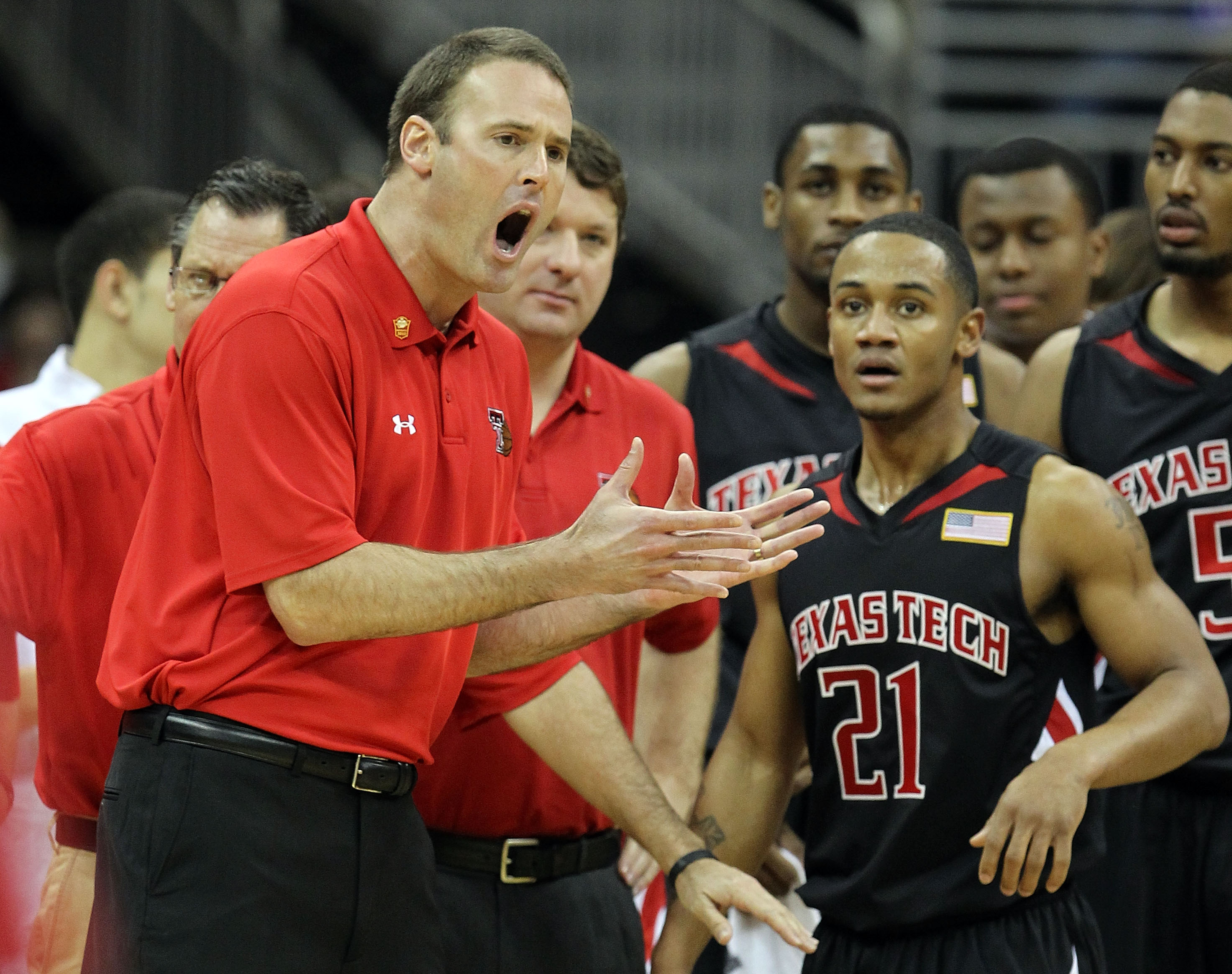 KANSAS CITY, MO - MARCH 11:  Head coach Pat Knight of the Texas Tech Red Raiders yells over at John Roberson #21 in the first half while taking on the Kansas Jayhawks during the quarterfinals of the 2010 Phillips 66 Big 12 Men's Basketball Tournament at t