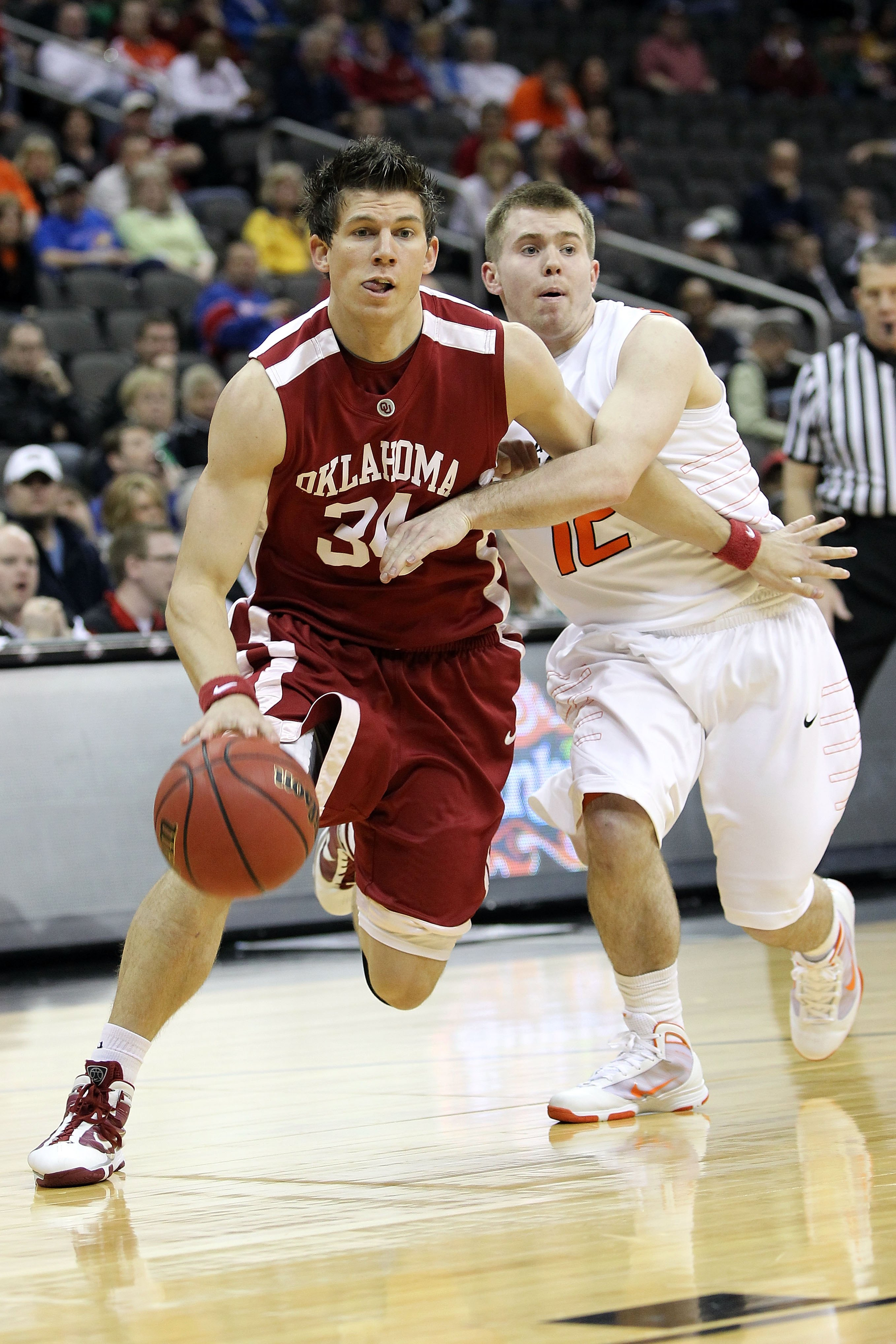 KANSAS CITY, MO - MARCH 10:  Cade Davis #34 of the Oklahoma Sooners drives on Keiton Page #12 of the Oklahoma State Cowboys during the first round game of the 2010 Phillips 66 Big 12 Men's Basketball Tournament at the Sprint Center on March 10, 2010 in Ka