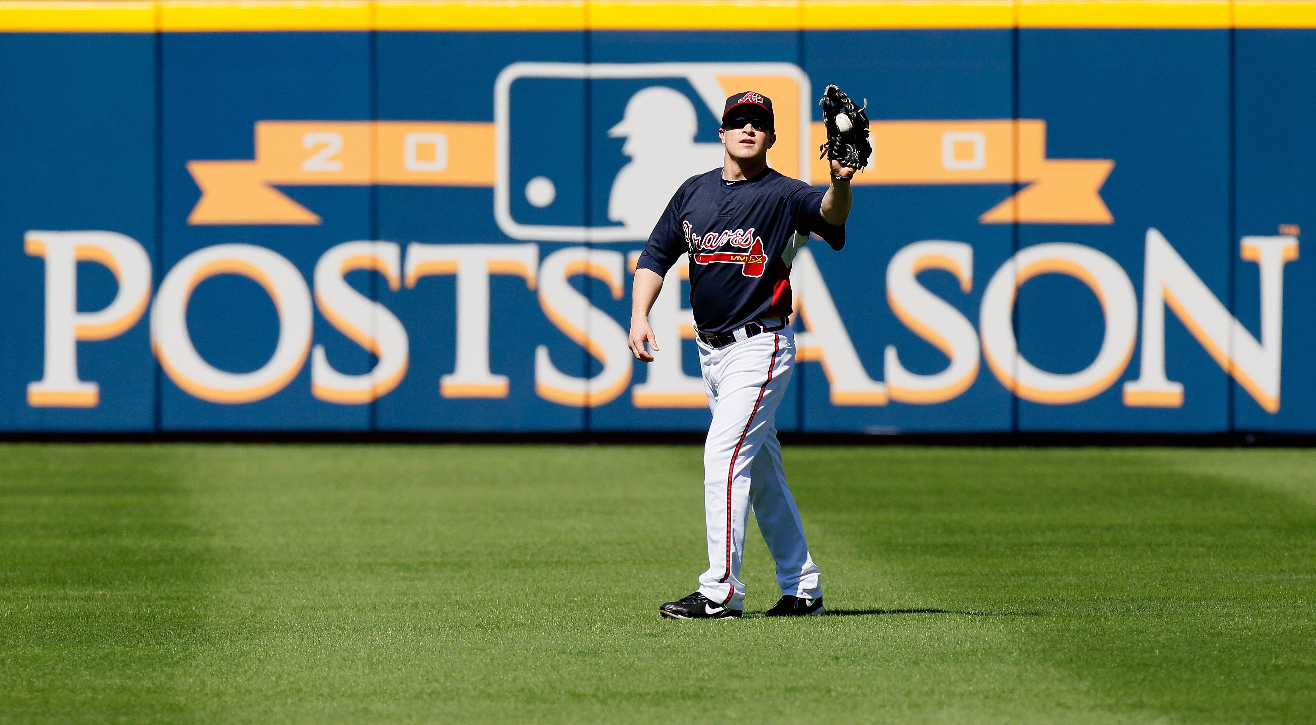 ATLANTA - OCTOBER 10:  Nate McLouth #24 of the Atlanta Braves warms up before facing the San Francisco Giants during Game Three of the NLDS of the 2010 MLB Playoffs at Turner Field on October 10, 2010 in Atlanta, Georgia.  (Photo by Kevin C. Cox/Getty Ima