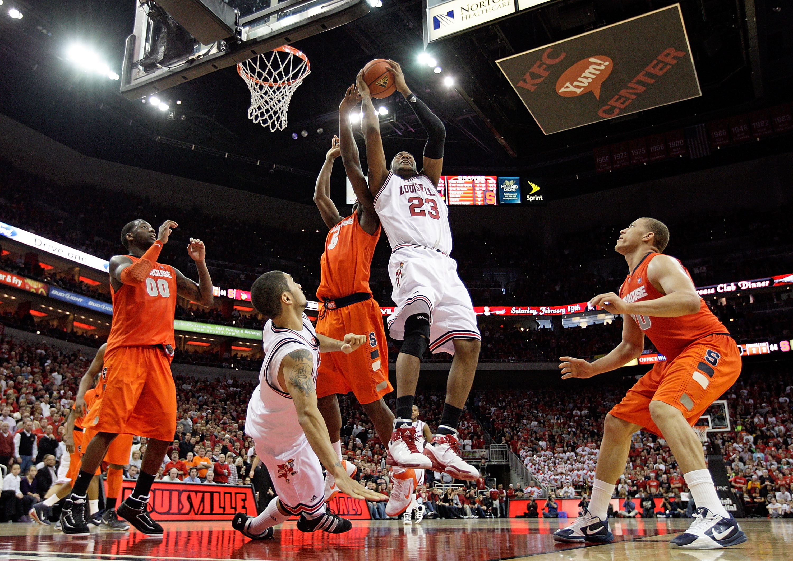 LOUISVILLE, KY - FEBRUARY 12:  Terrence Jennings #23 of the Louisville Cardinals reaches for a rebound  during the Big East Conference game against the Syracuse Orange at the KFC Yum! Center on February 12, 2011 in Louisville, Kentucky.  Louisville won73-