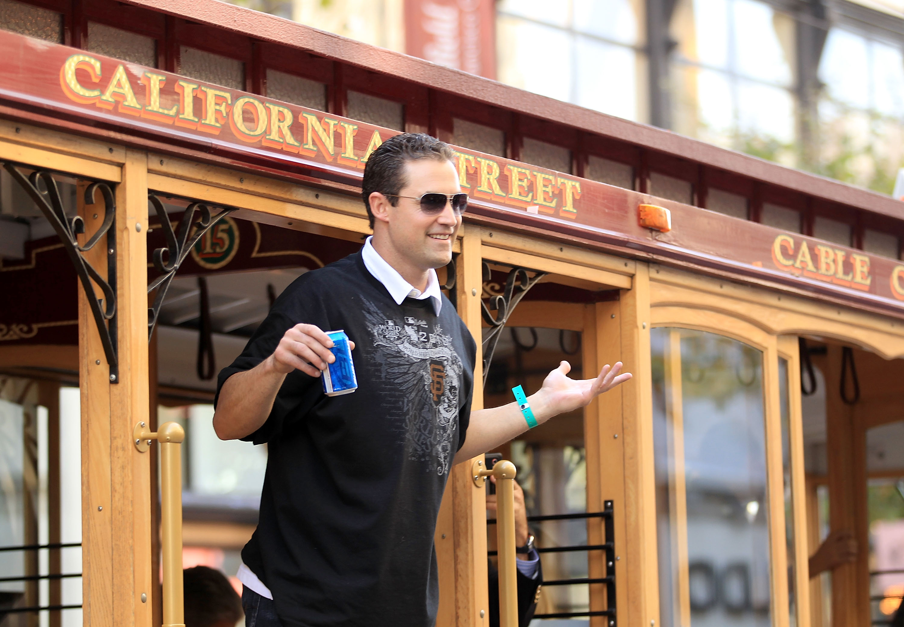 SAN FRANCISCO - NOVEMBER 03:  Pat Burrell of the San Francisco Giants rides a cable car during the San Francisco Giants victory parade on November 3, 2010 in San Francisco, California.  (Photo by Ezra Shaw/Getty Images)