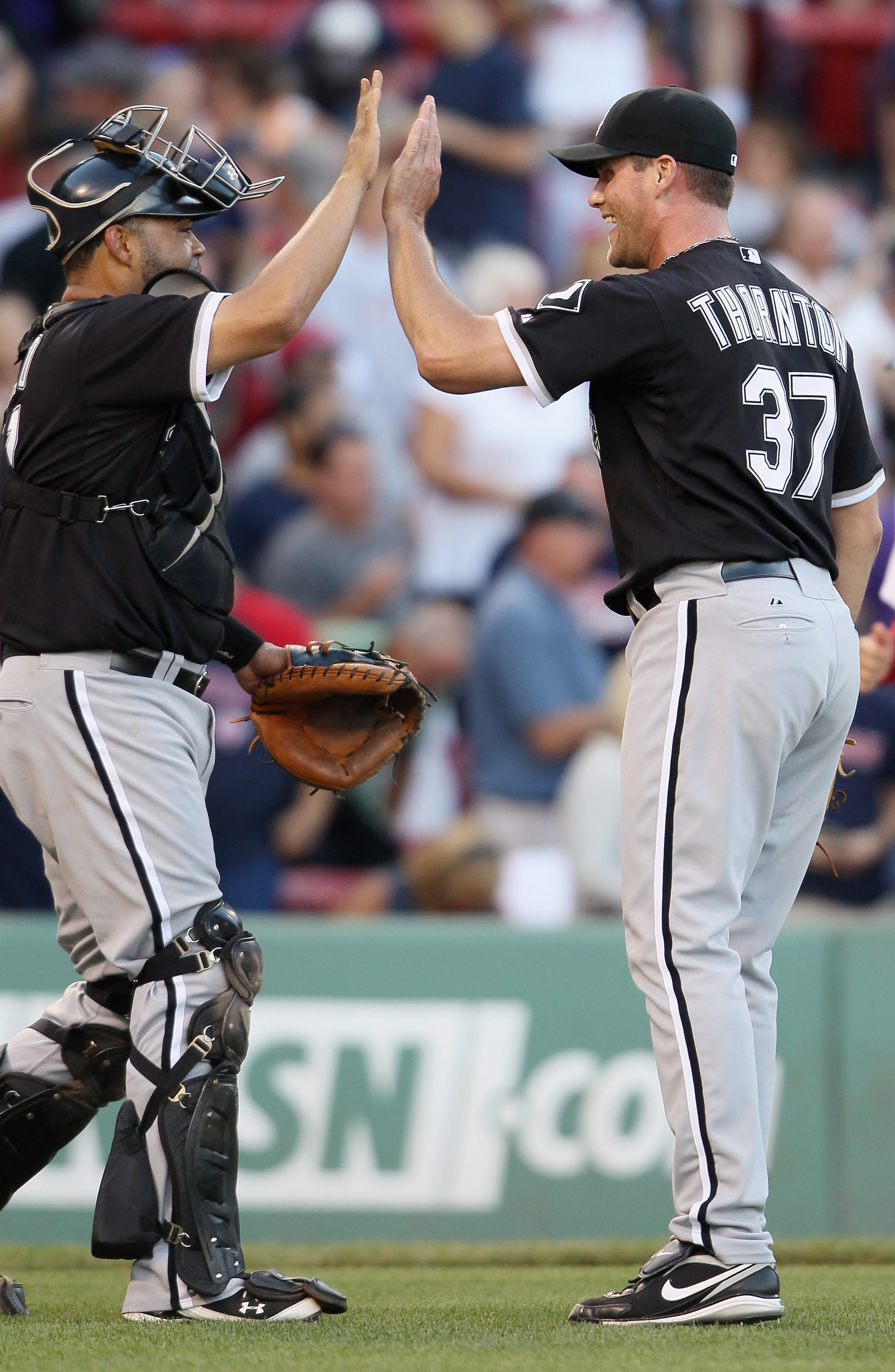 BOSTON - SEPTEMBER 05:  Matt Thornton #37 of the Chicago White Sox celebrates the win with Ramon Castro #27 on September 5, 2010 at Fenway Park in Boston, Massachusetts.The White Sox defeated the Boston Red Sox 7-5.  (Photo by Elsa/Getty Images)