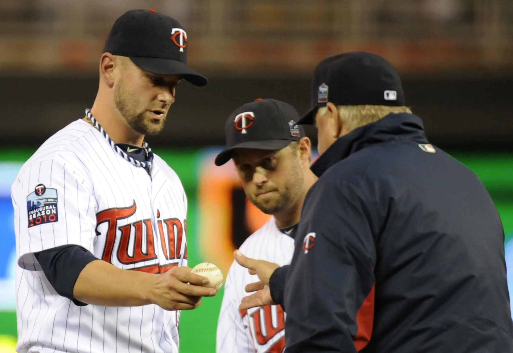 MINNEAPOLIS, MN - OCTOBER 6: Jesse Crain #28 of the Minnesota Twins is pulled from game one of the ALDS against the New York Yankees by manager Ron Gardenhire #35 on October 6, 2010 at Target Field in Minneapolis, Minnesota. (Photo by Hannah Foslien /Gett