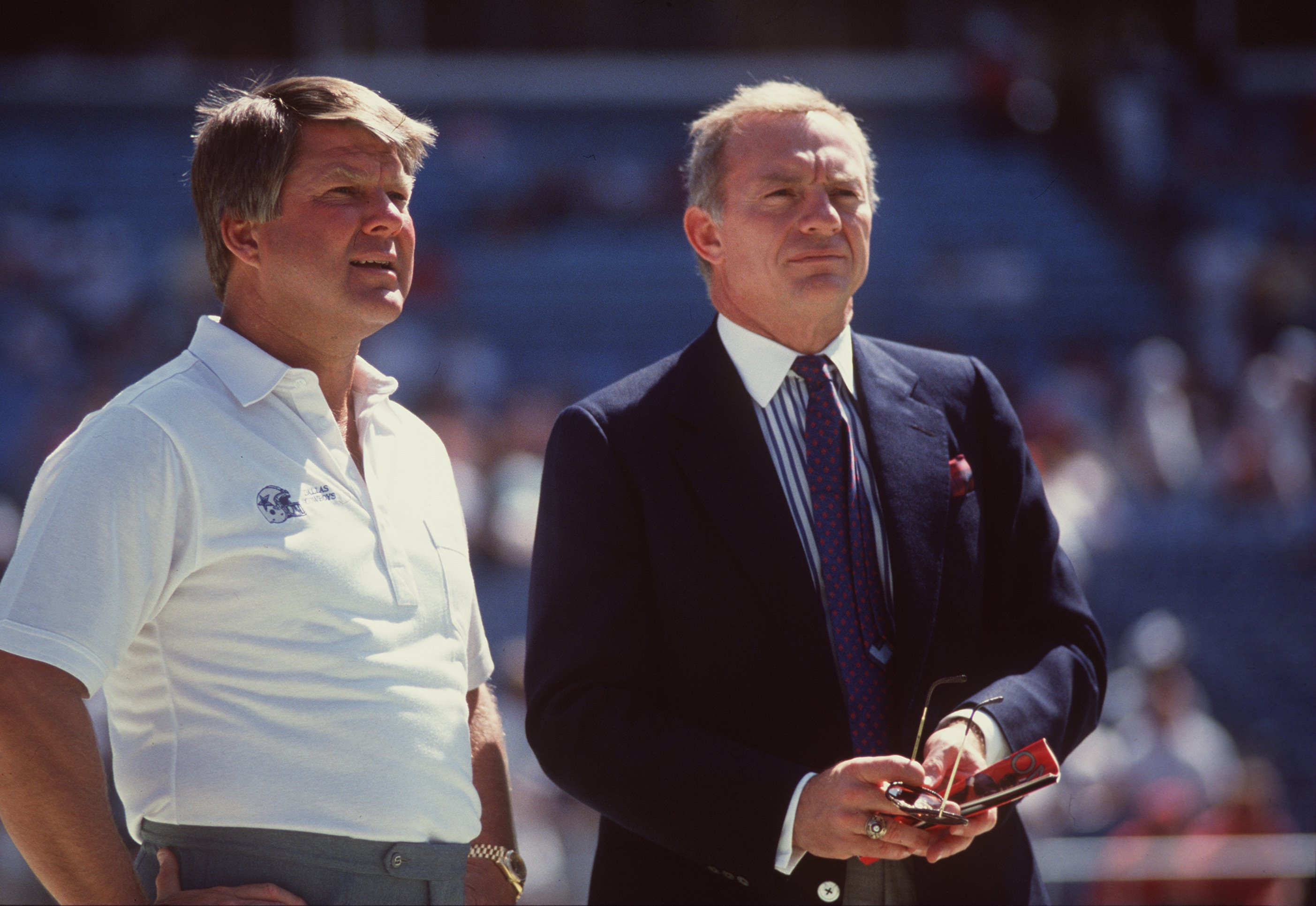 1990:  Owner Jerry Jones of the Dallas Cowboys has a conversation with team head coach Jimmy Johnson on the sidelines during pre game warm ups before the Cowboys 27-21 loss to the Atlanta Falcons at Texas Stadium in Irving, Texas.   Mandatory Credit: Alls