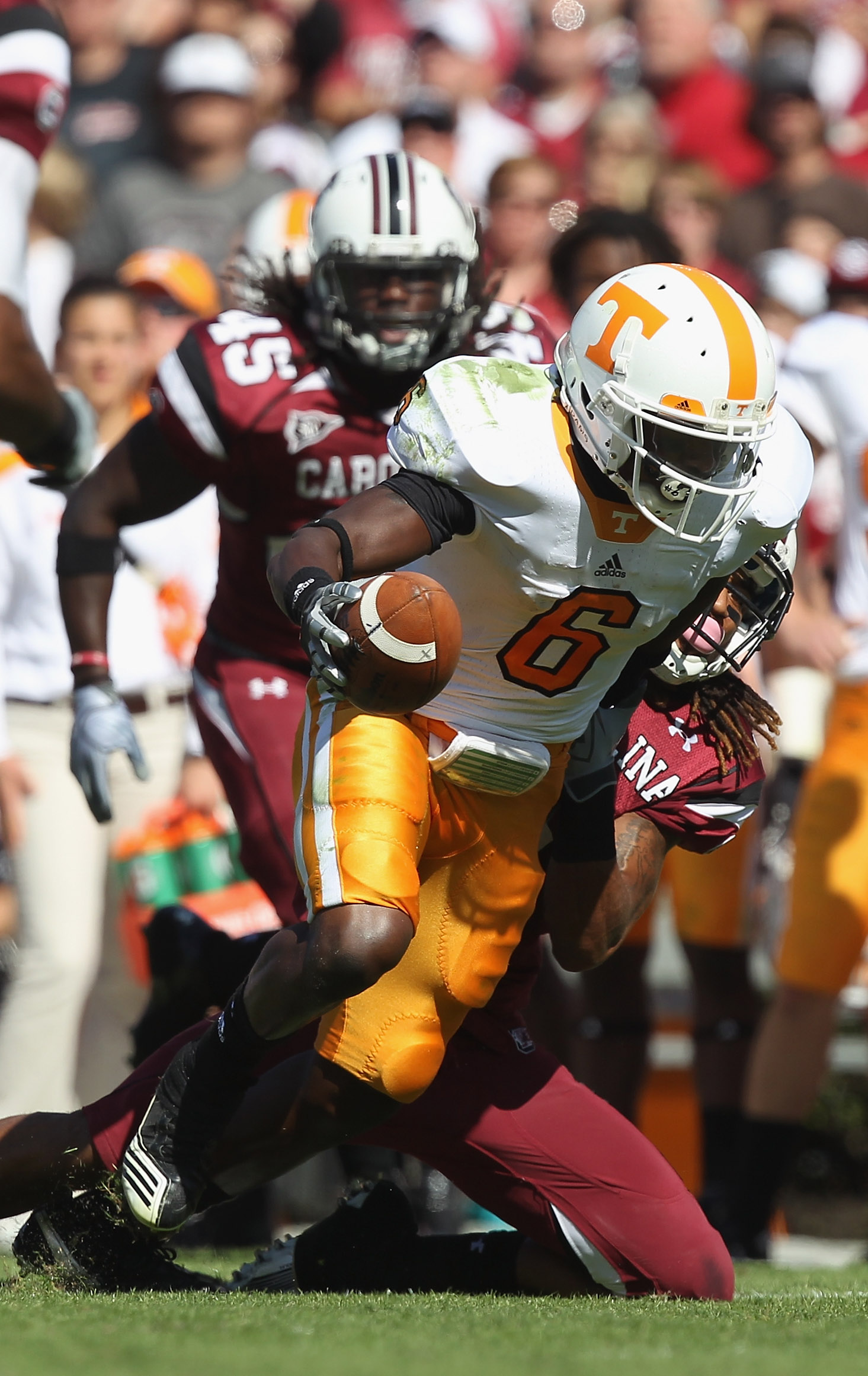 COLUMBIA, SC - OCTOBER 30:  Denarius Moore #6 of the Tennessee Volunteers is tackled by Melvin Ingram #6 of the South Carolina Gamecocks during their game at Williams-Brice Stadium on October 30, 2010 in Columbia, South Carolina.  (Photo by Streeter Lecka