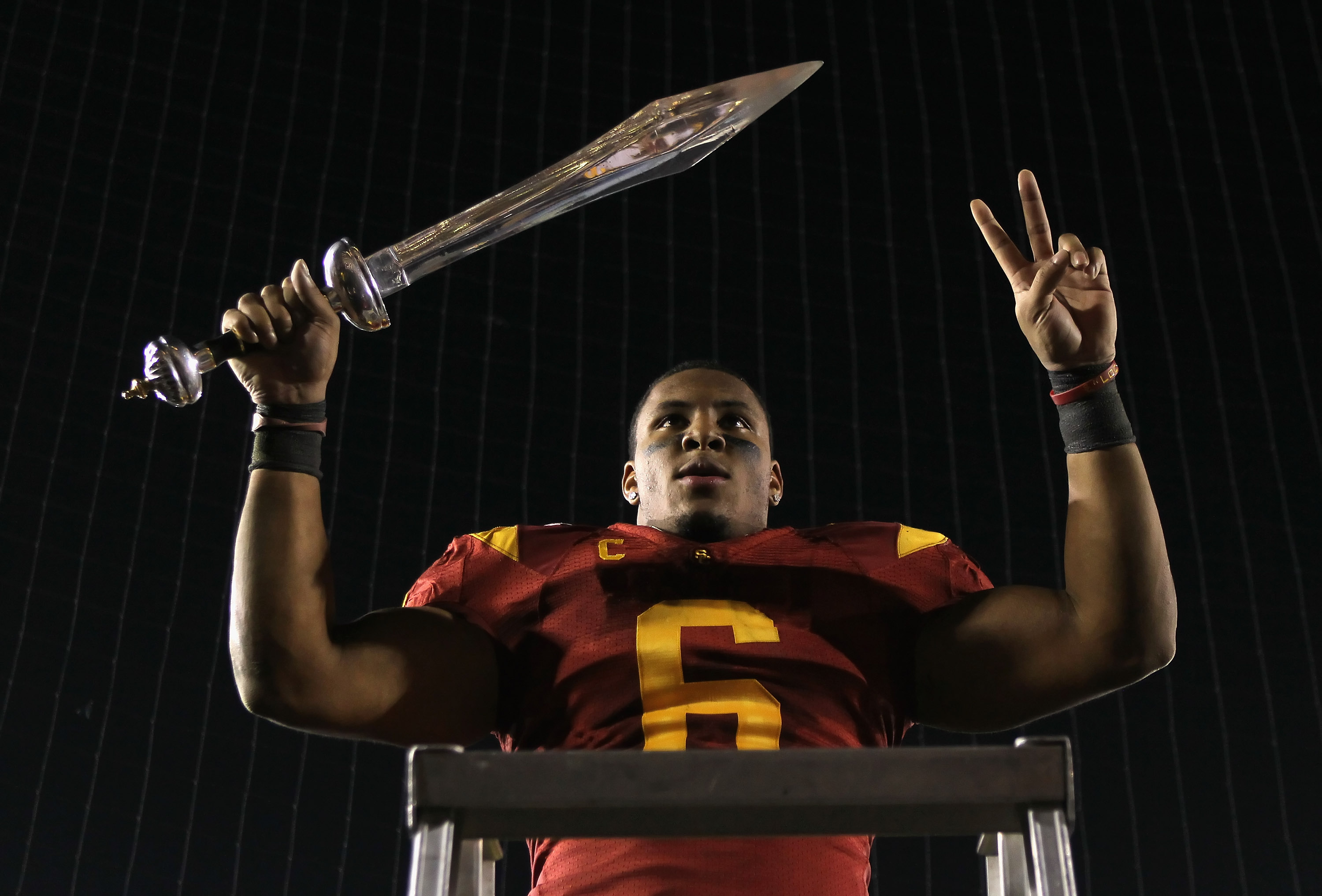 PASADENA, CA - DECEMBER 04:  Malcolm Smith #6 of the USC Trojans celebrates following his teams victory over the UCLA Bruins at the Rose Bowl on December 4, 2010 in Pasadena, California.  USC defeated UCLA 28-14.  (Photo by Jeff Gross/Getty Images)