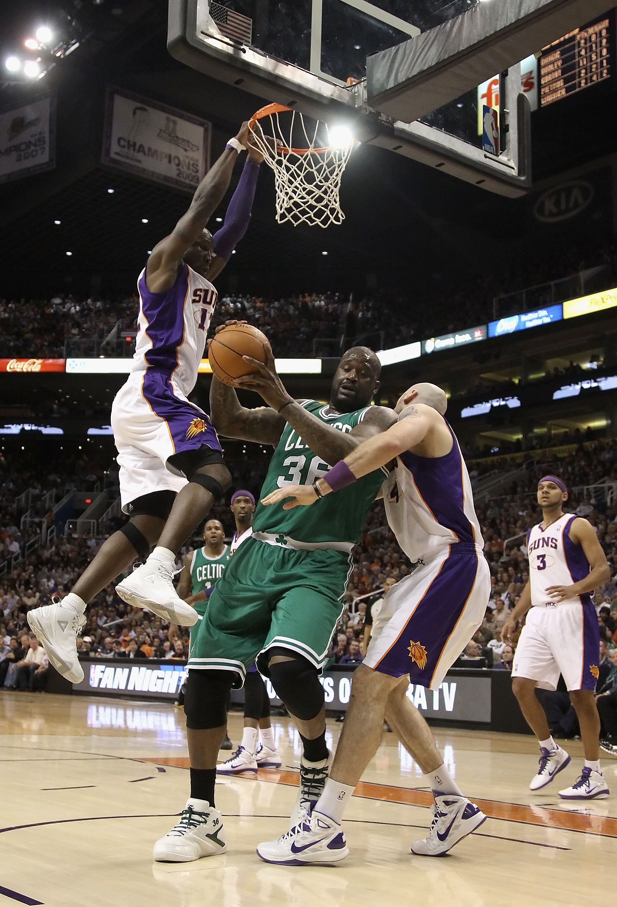 PHOENIX, AZ - JANUARY 28:  Shaquille O'Neal #36 of the Boston Celtics handles the ball during the NBA game against the Phoenix Suns at US Airways Center on January 28, 2011 in Phoenix, Arizona.  The Suns defeated the Celtics 88-71.  NOTE TO USER: User exp
