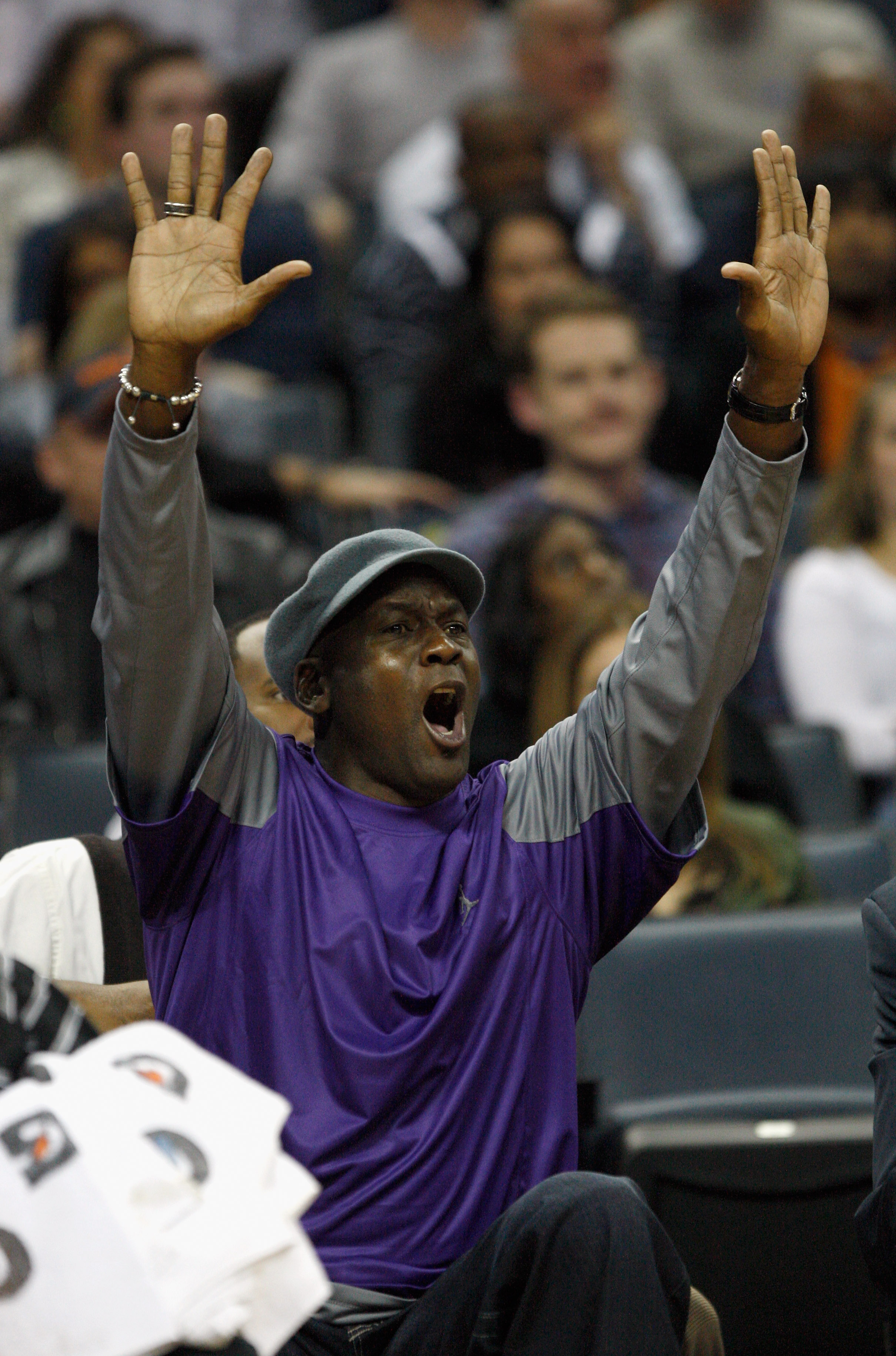 CHARLOTTE, NC - FEBRUARY 11:  Charlotte Bobcats owner, Michael Jordan, reacts to a call while sitting on the bench during their game against the New Jersey Nets at Time Warner Cable Arena on February 11, 2011 in Charlotte, North Carolina. NOTE TO USER: Us