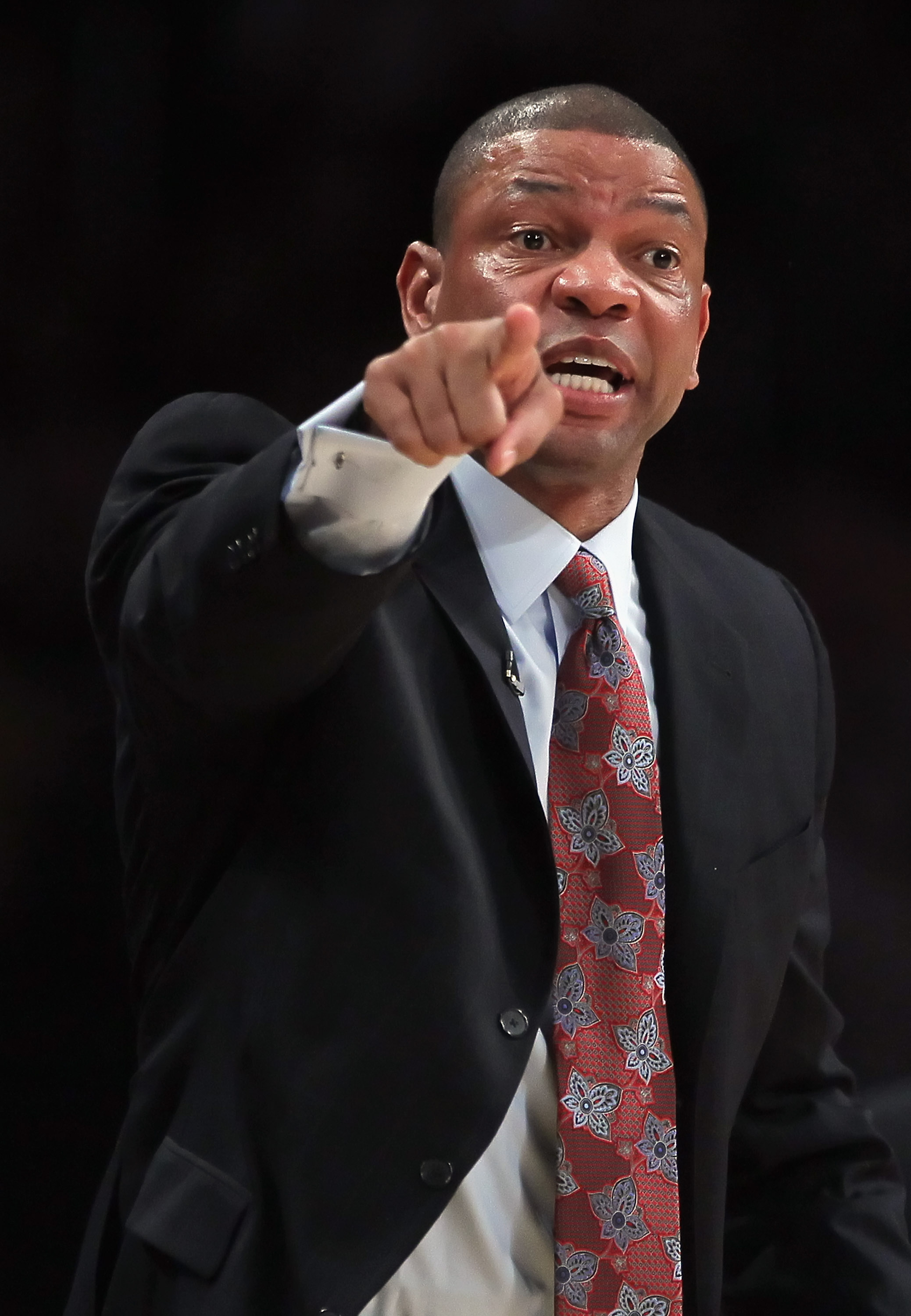 LOS ANGELES, CA - JANUARY 30:  Boston Celtics head coach Doc Rivers shouts instructions from the bench against the Los Angeles Lakers at Staples Center on January 30, 2011 in Los Angeles, California. The Celtics defeated the Lakers 109-96.  (Photo by Jeff