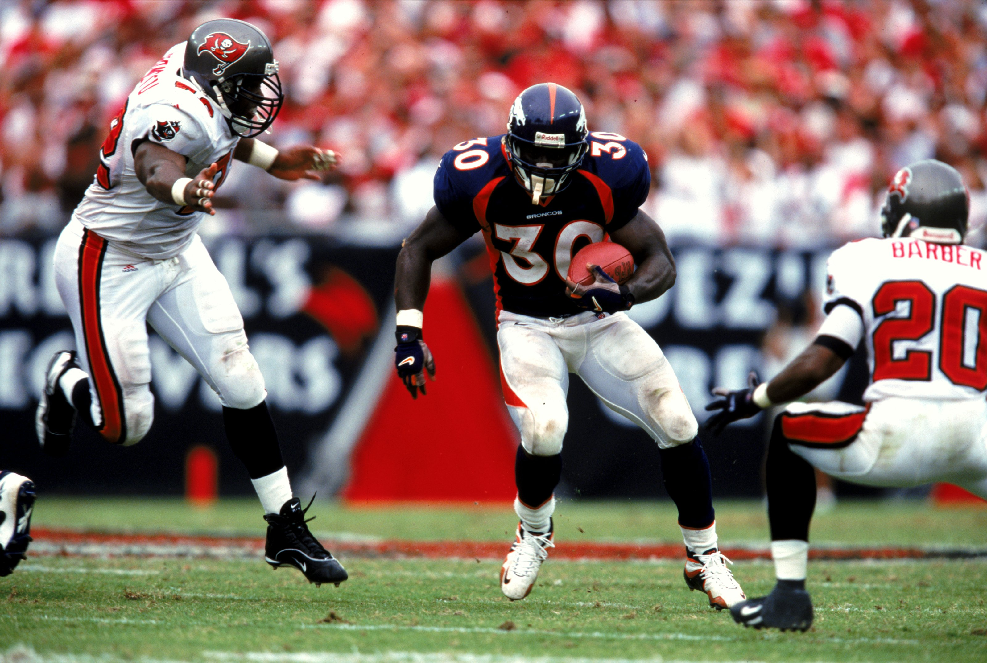 26 Sep 1999: Terrell Davis #30 of the Denver Broncos carries the ball during the game against the Tampa Bay Buccaneers at the Raymond James Stadium in Tampa Bay, Florida. The Buccaneers defeated the Broncos 13-10. Mandatory Credit: Andy Lyons  /Allsport