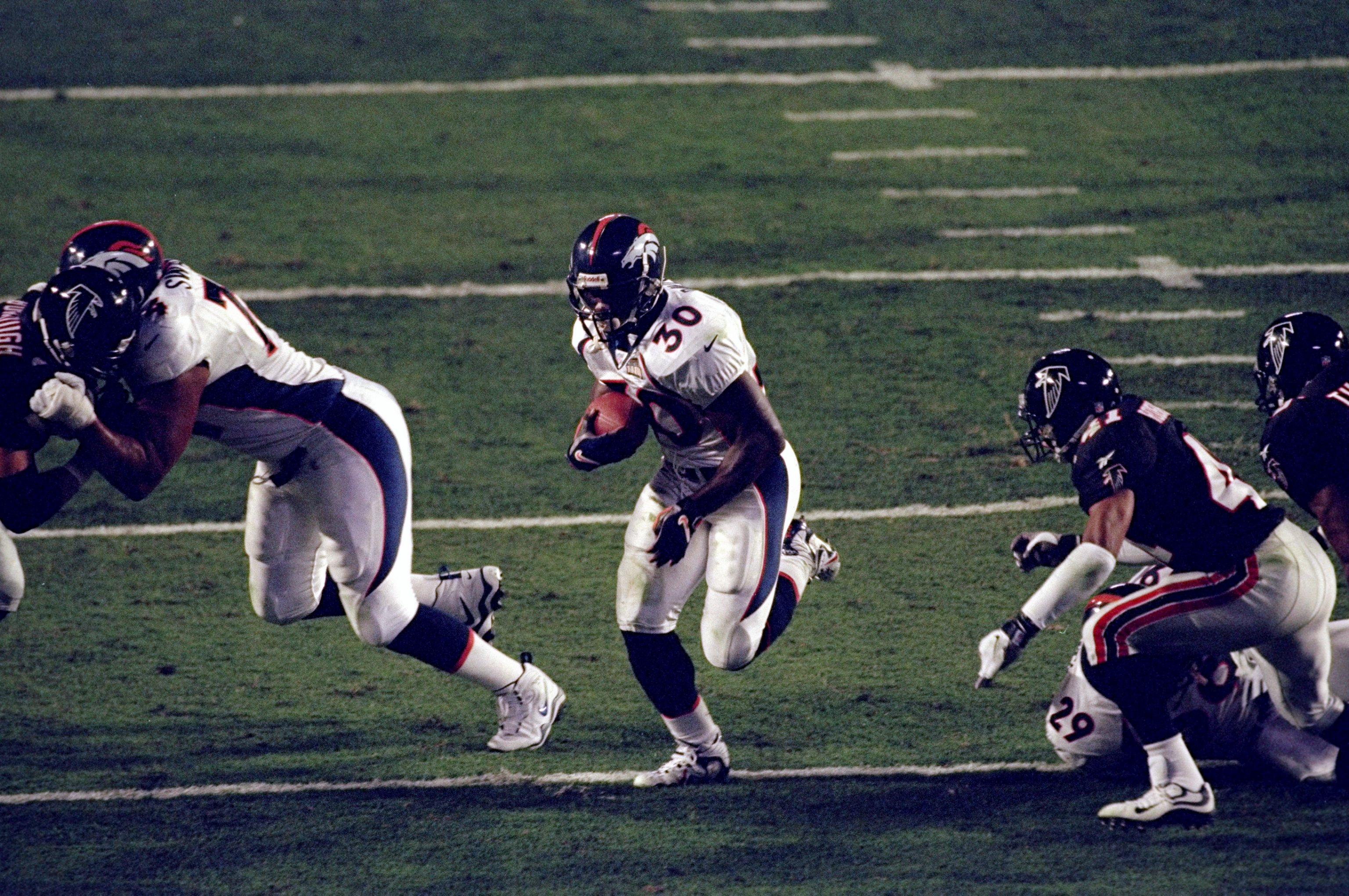 31 Jan 1999:  Terrell Davis #30 of the Denver Broncos in action during the Super Bowl XXXIII Game against the Atlanta Falcons at the Pro Player Stadium in Miami, Florida. The Broncos defeated the Falcons 34-19.
