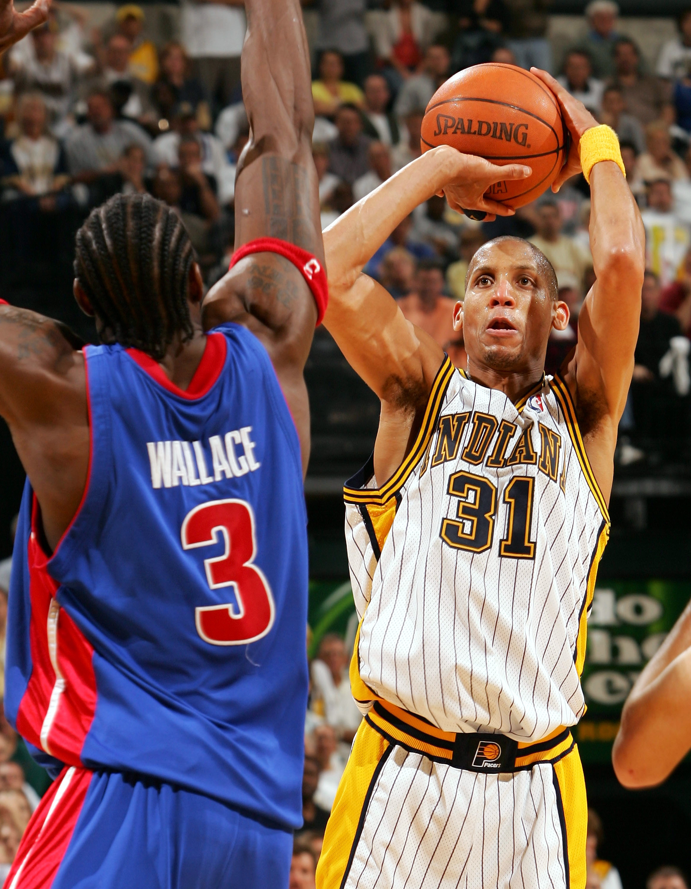 INDIANAPOLIS - MAY 13:  Reggie Miller #31 of the Indiana Pacers shoots against Ben Wallace #3 of the Detroit Pistons in Game three of the Eastern Conference Semifinals during the 2005 NBA Playoffs at Conseco Fieldhouse on May 13, 2005 in Indianapolis, Ind