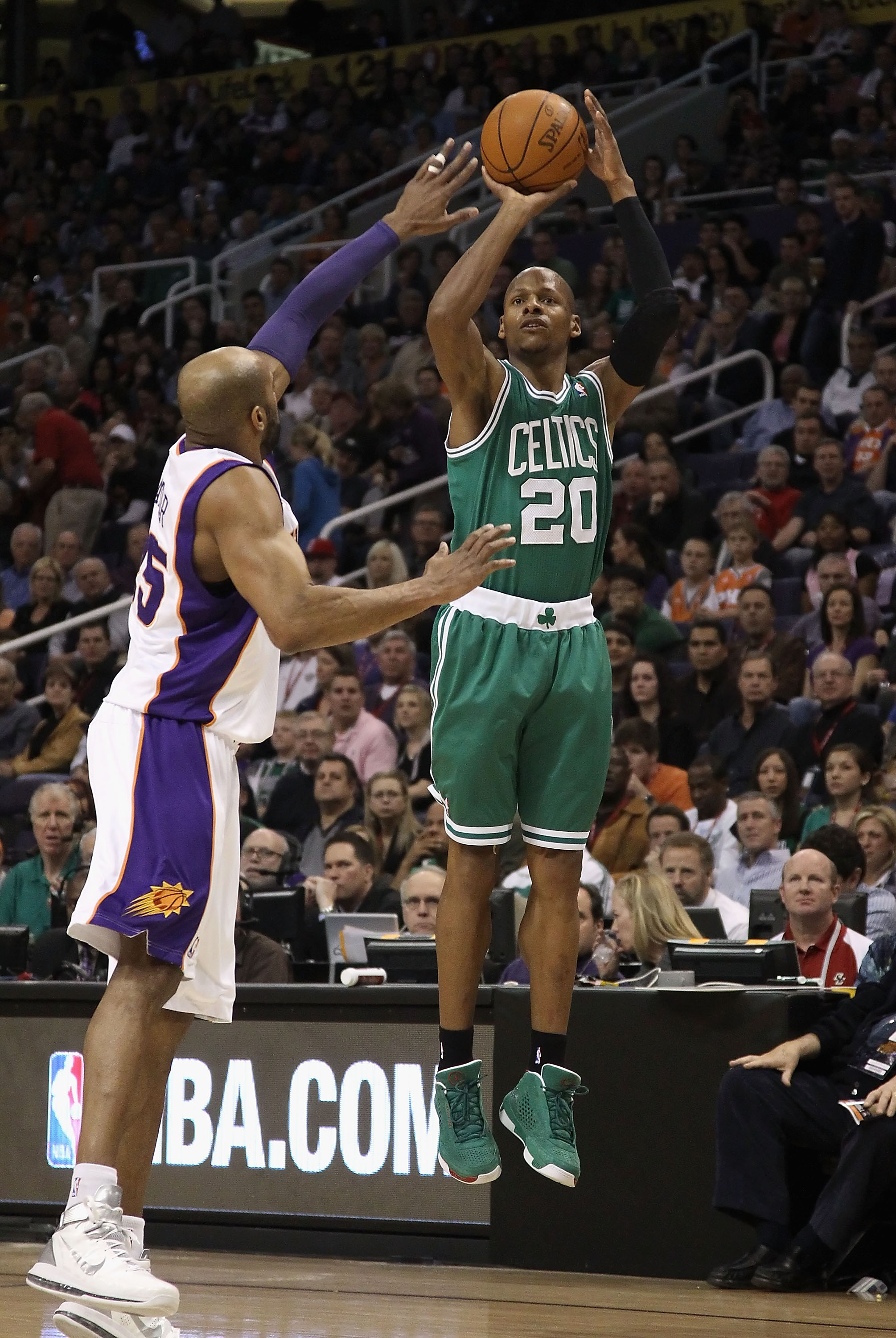 PHOENIX, AZ - JANUARY 28:  Ray Allen #20 of the Boston Celtics attempts a three point shot over Vince Carter #25 of the Phoenix Suns during the NBA game at US Airways Center on January 28, 2011 in Phoenix, Arizona. The Suns defeated the Celtics 88-71.  NO