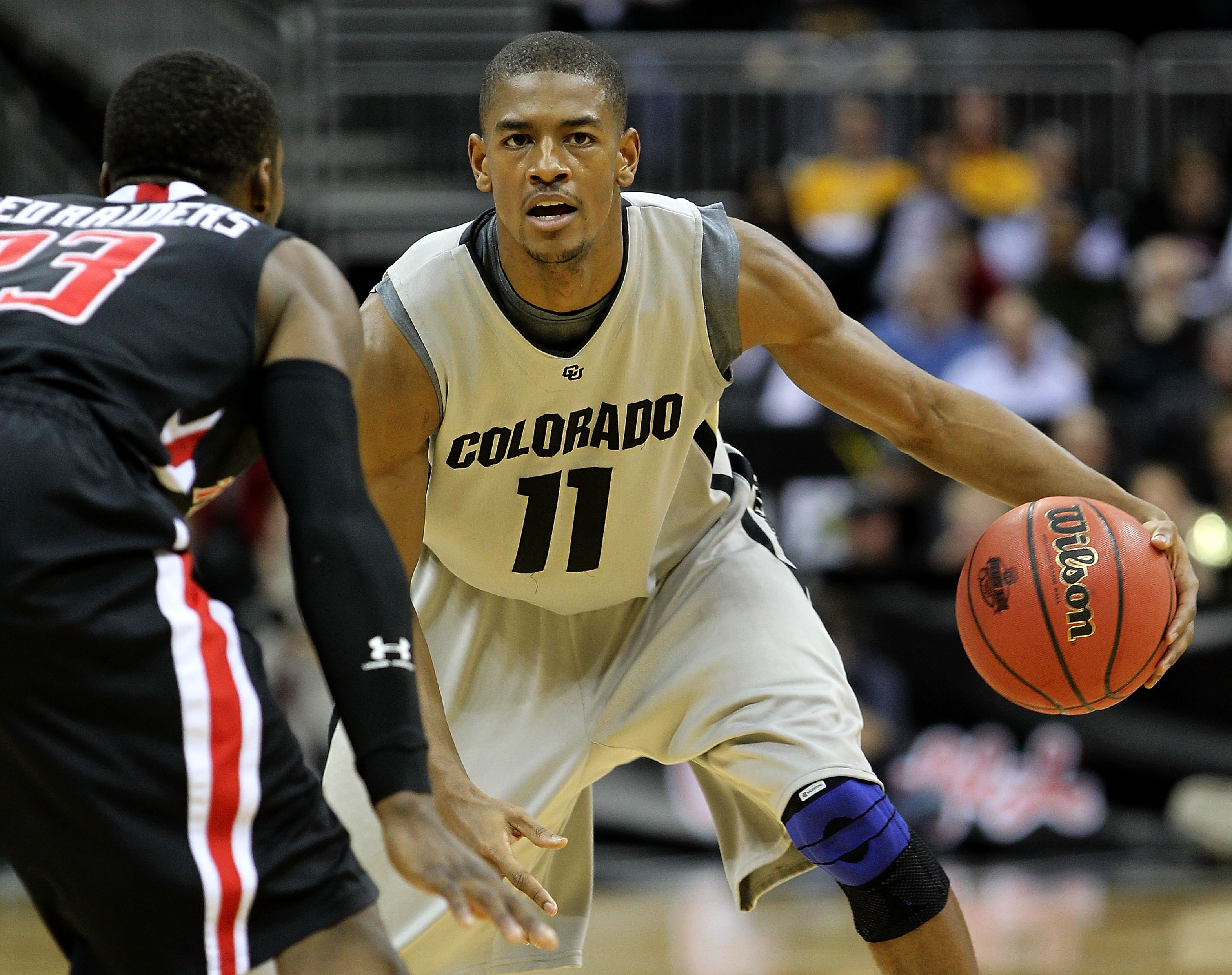 KANSAS CITY, MO - MARCH 10:  Cory Higgins #11 of the Colorado Buffaloes moves the ball against the Texas Tech Red Raiders in the first half during the first round game of the 2010 Phillips 66 Big 12 Men's Basketball Tournament at the Sprint Center on Marc
