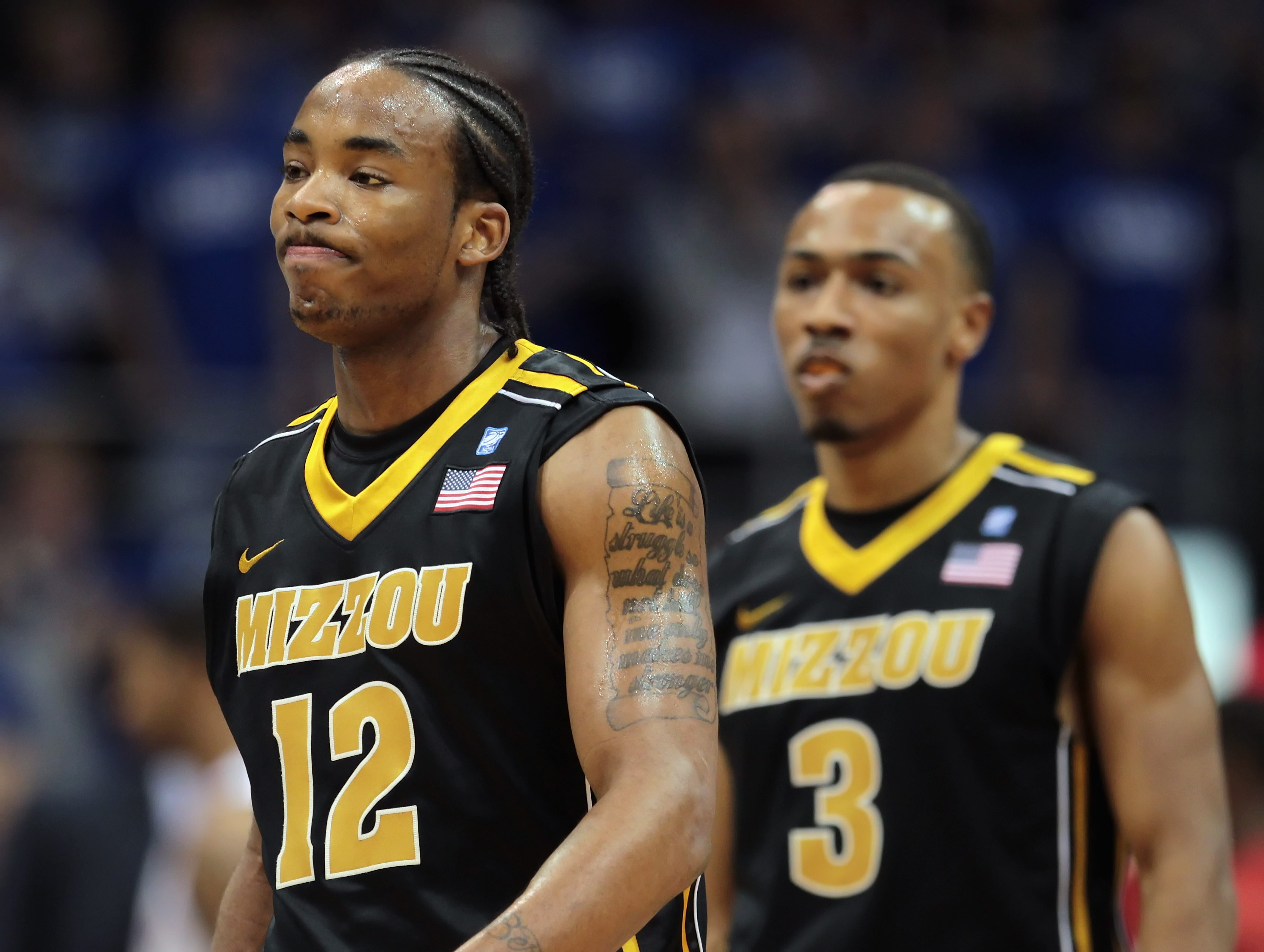 LAWRENCE, KS - FEBRUARY 07:  Marcus Denmon #12 and Matt Pressey #3 of the Missouri Tigers reacts after a foul during the game against the Kansas Jayhawks on February 5, 2011 at Allen Fieldhouse in Lawrence, Kansas.  (Photo by Jamie Squire/Getty Images)