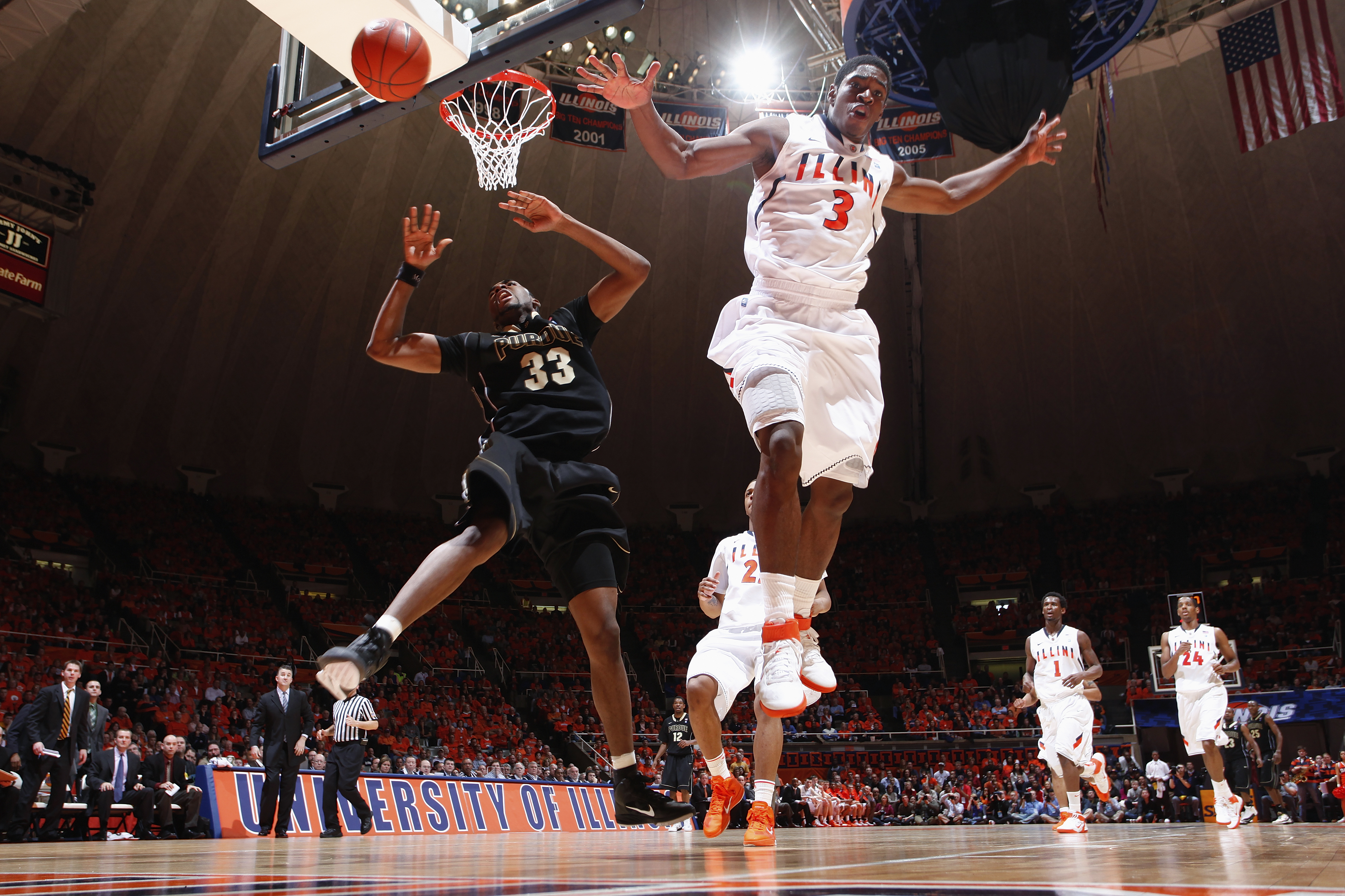 CHAMPAIGN, IL - FEBRUARY 13: Brandon Paul #3 of the Illinois Fighting Illini blocks a layup by E'Twaun Moore #33 of the Purdue Boilermakers at Assembly Hall on February 13, 2011 in Champaign, Illinois. Purdue defeated Illinois 81-70. (Photo by Joe Robbins