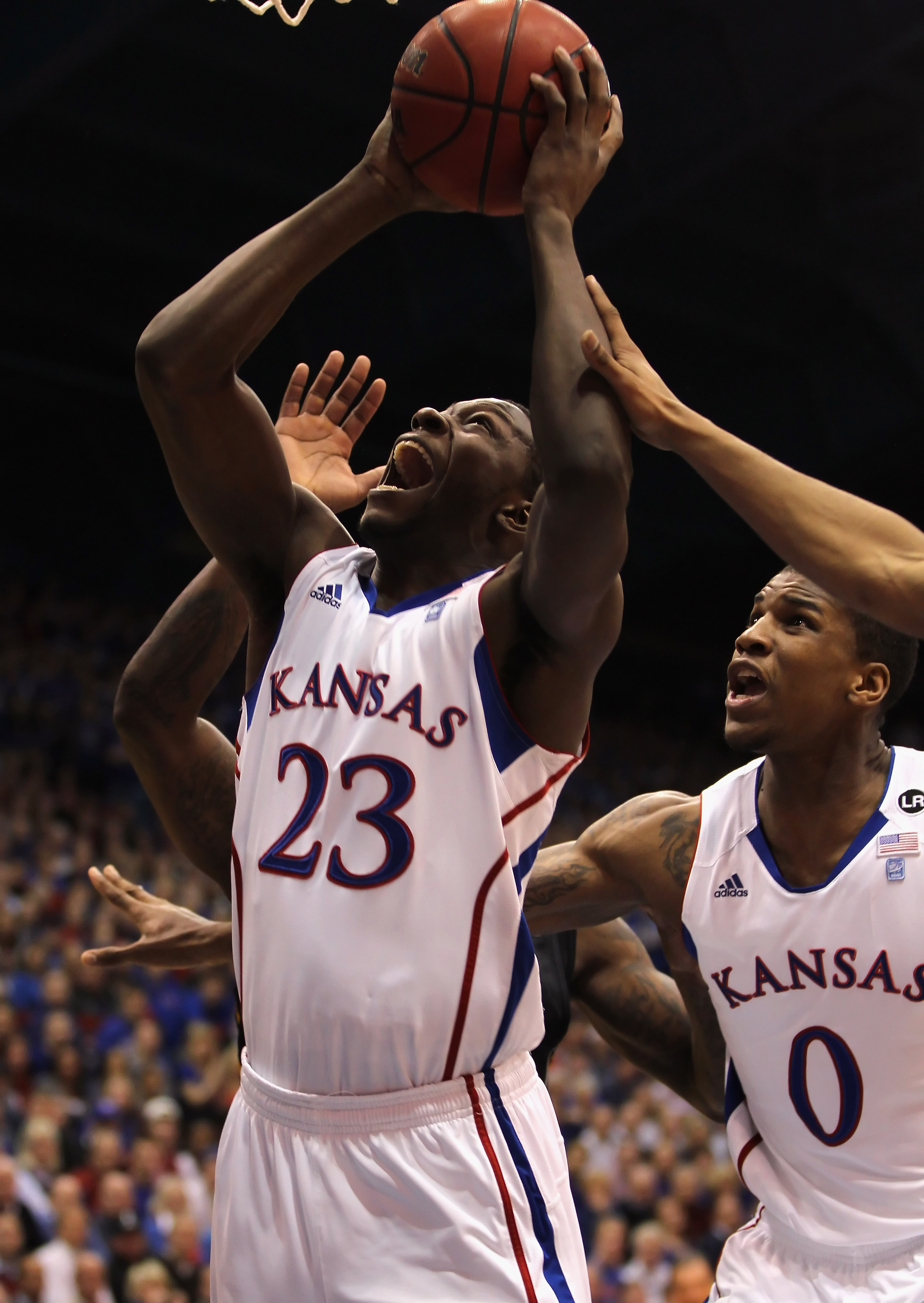 LAWRENCE, KS - FEBRUARY 07:  Mario Little #23 of the Kansas Jayhawks shoots during the game against the Missouri Tigers on February 7, 2011 at Allen Fieldhouse in Lawrence, Kansas.  (Photo by Jamie Squire/Getty Images)
