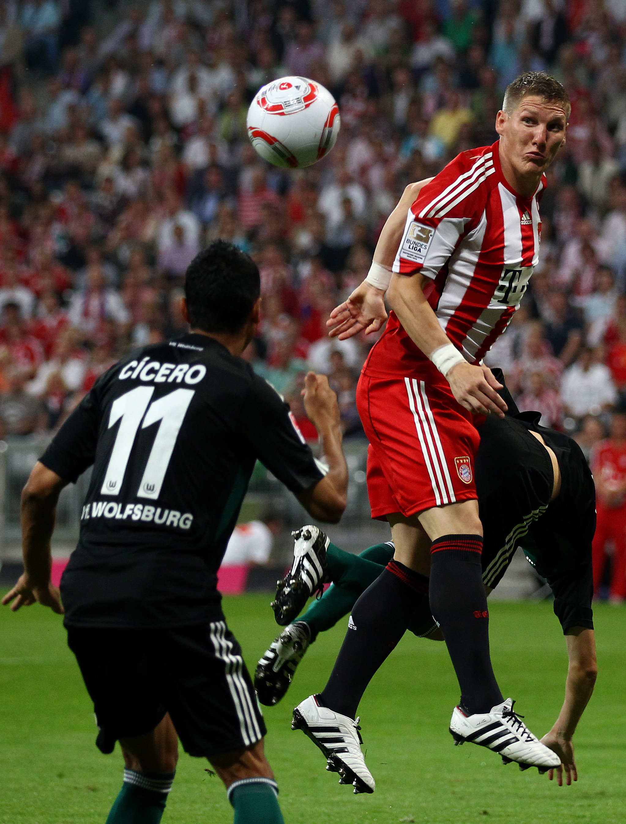 MUNICH, GERMANY - AUGUST 20: Bastian Schweinsteiger of Bayern jumps for a header during the Bundesliga match between FC Bayern Muenchen and VfL Wolfsburg at Allianz Arena on August 20, 2010 in Munich, Germany.  (Photo by Clive Brunskill/Getty Images)