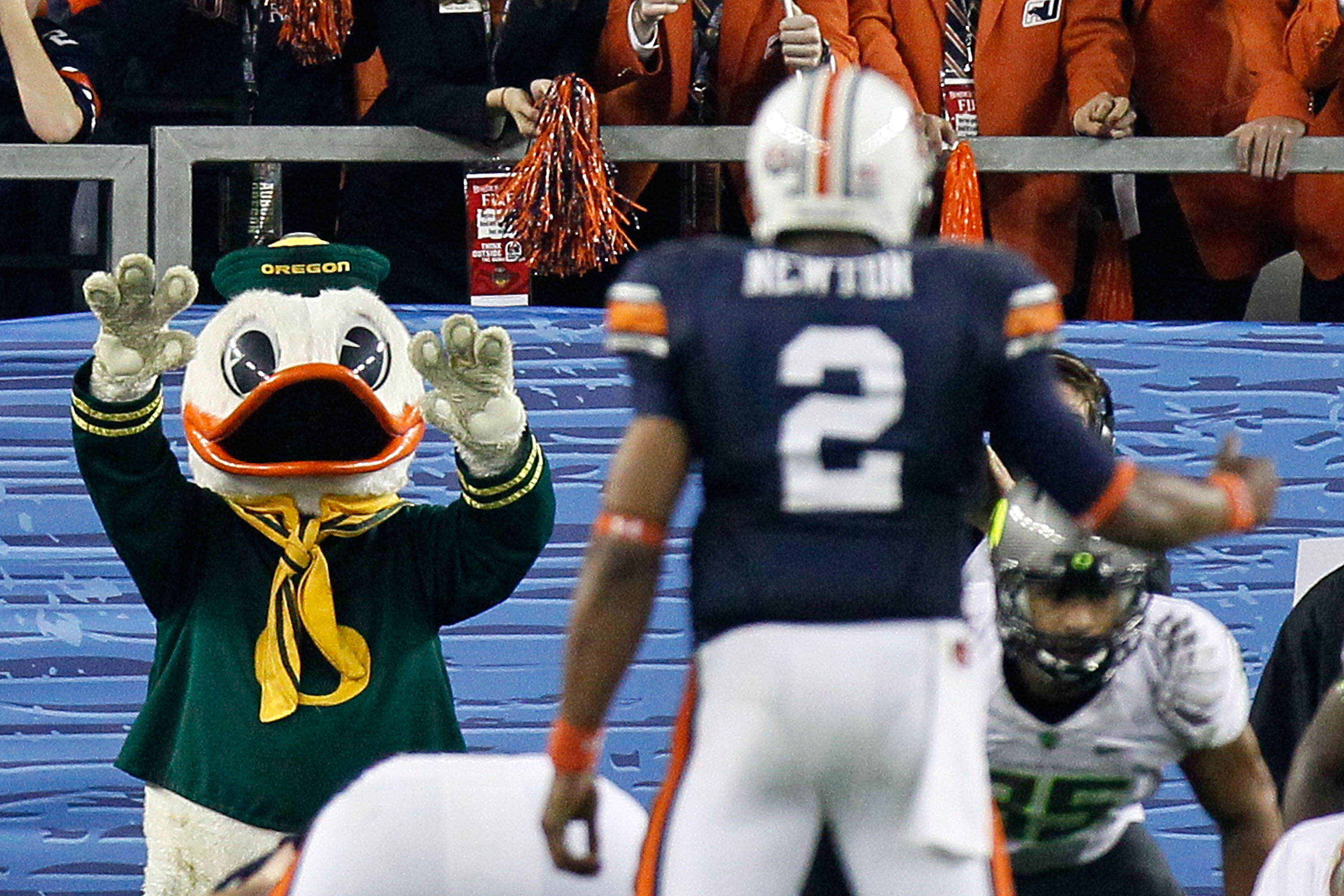 GLENDALE, AZ - JANUARY 10:  The Oregon Duck mocks Cameron Newton #2 of the Auburn Tigers  during the Tostitos BCS National Championship Game at University of Phoenix Stadium on January 10, 2011 in Glendale, Arizona.  (Photo by Kevin C. Cox/Getty Images)