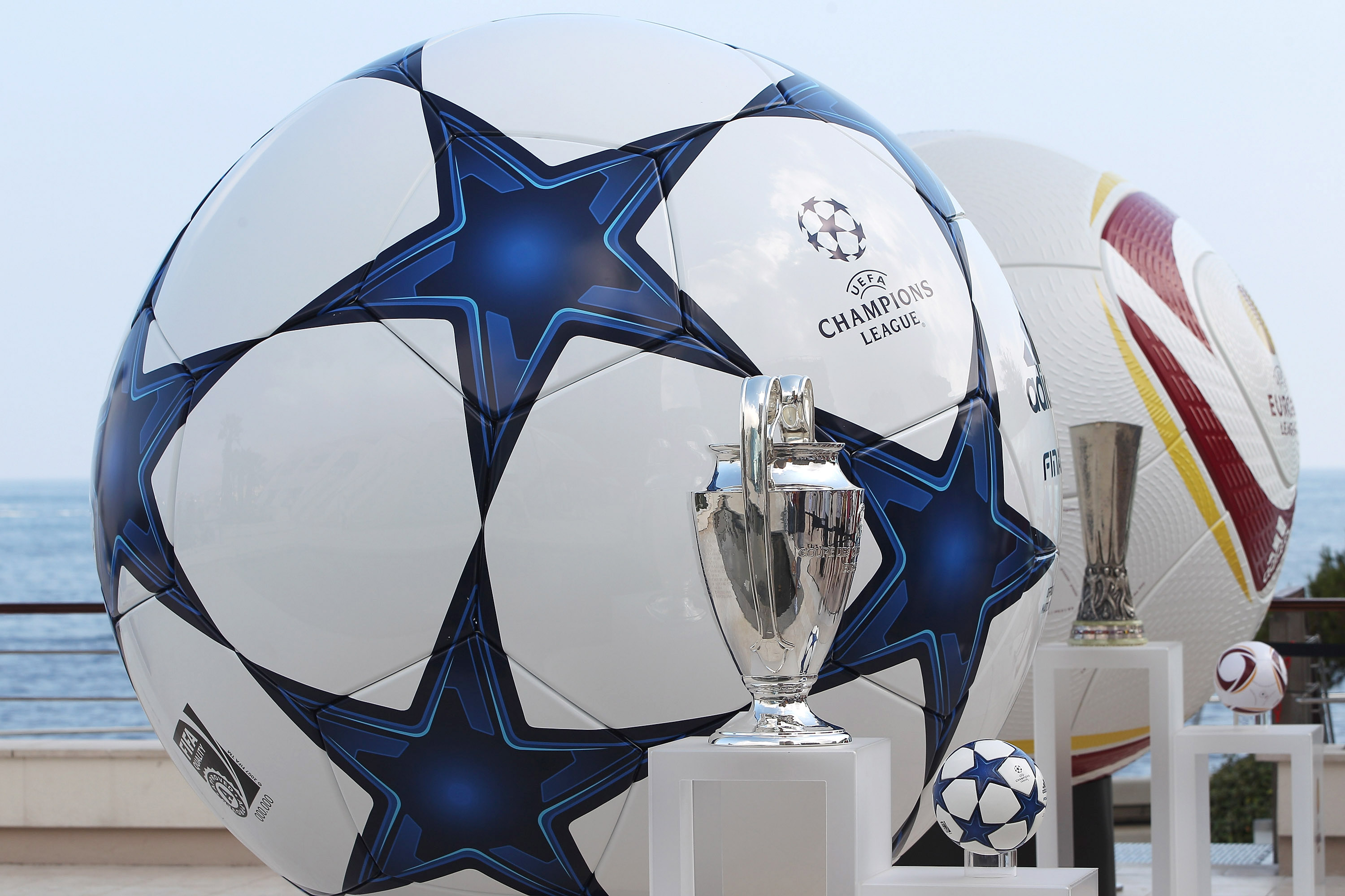 MONACO - AUGUST 26:  Adidas balls on show alongside the three main European club trophies, the Champions League, Europa League and Super Cup during the UEFA Champions League Group Stage draw at the Grimaldi Forum on August 26, 2010 in Monaco, Monaco.  (Ph
