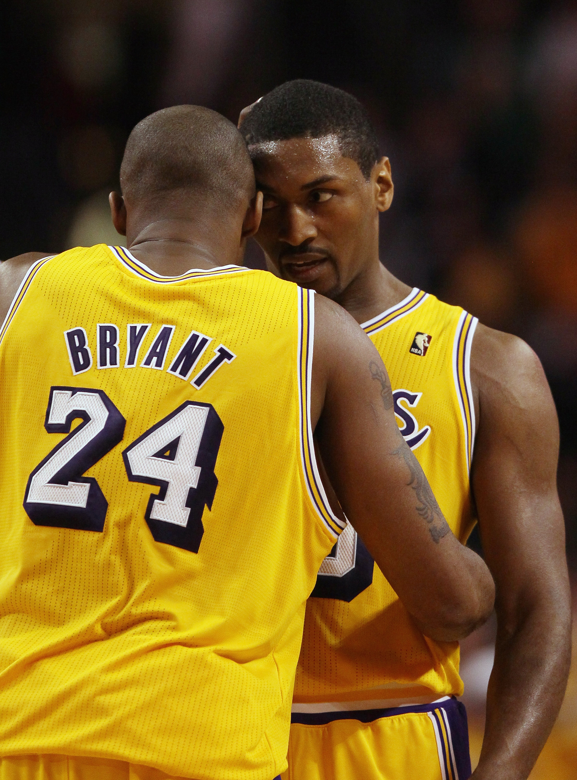 BOSTON, MA - FEBRUARY 10:  Ron Artest #15 and Kobe Bryant #24 of the Los Angeles Lakers talk during a stop in play in the second half against the Boston Celtics on February 10, 2011 at the TD Garden in Boston, Massachusetts.  The Lakers defeated the Celti