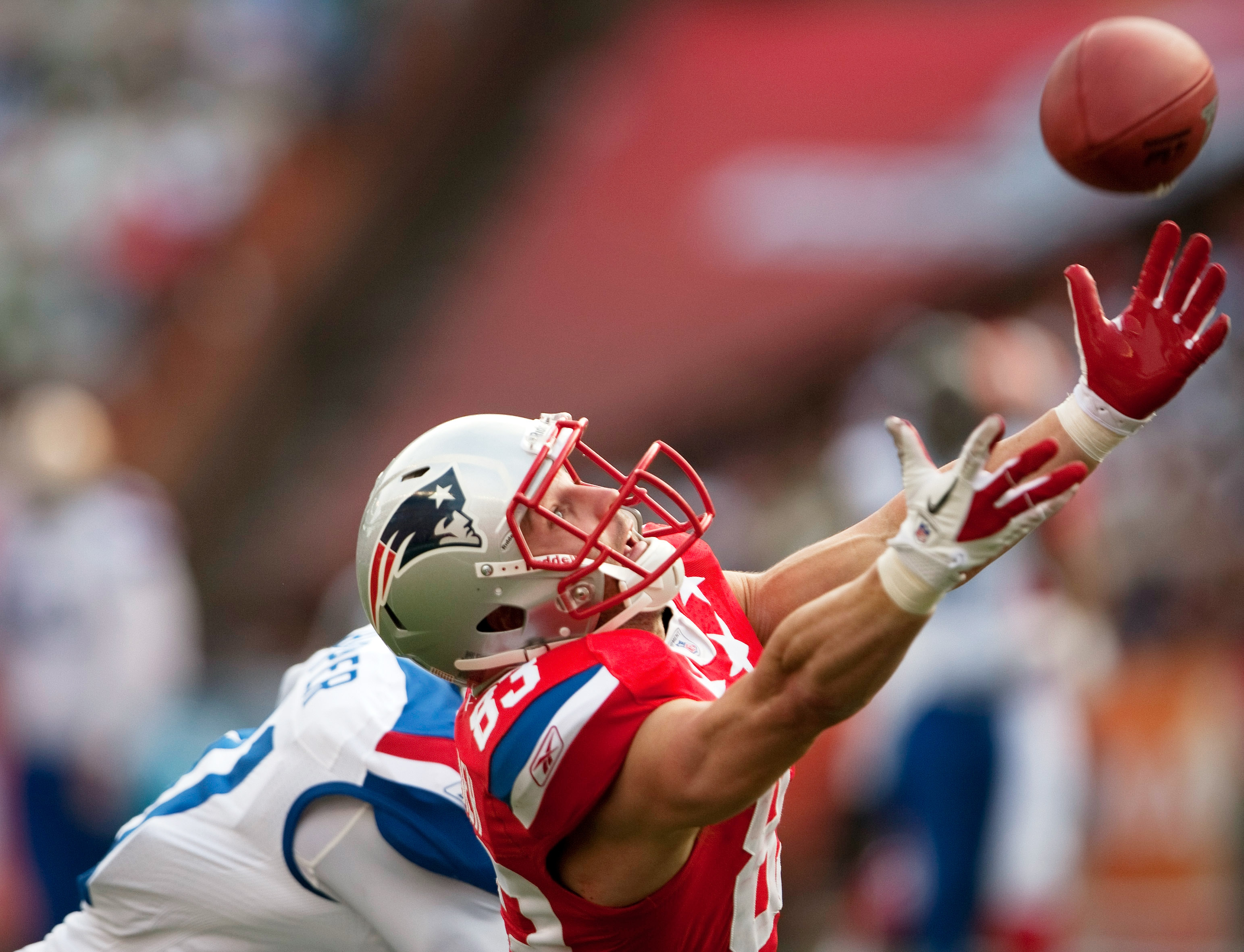 HONOLULU - JANUARY 30:  Wes Welker, #83 of the New England Patriots tries to reel in a pass during the 2011 NFL Pro Bowl at Aloha Stadium on January 30, 2011 in Honolulu, Hawaii. NFC won 55-41 over the AFC. (Photo by Kent Nishimura/Getty Images)