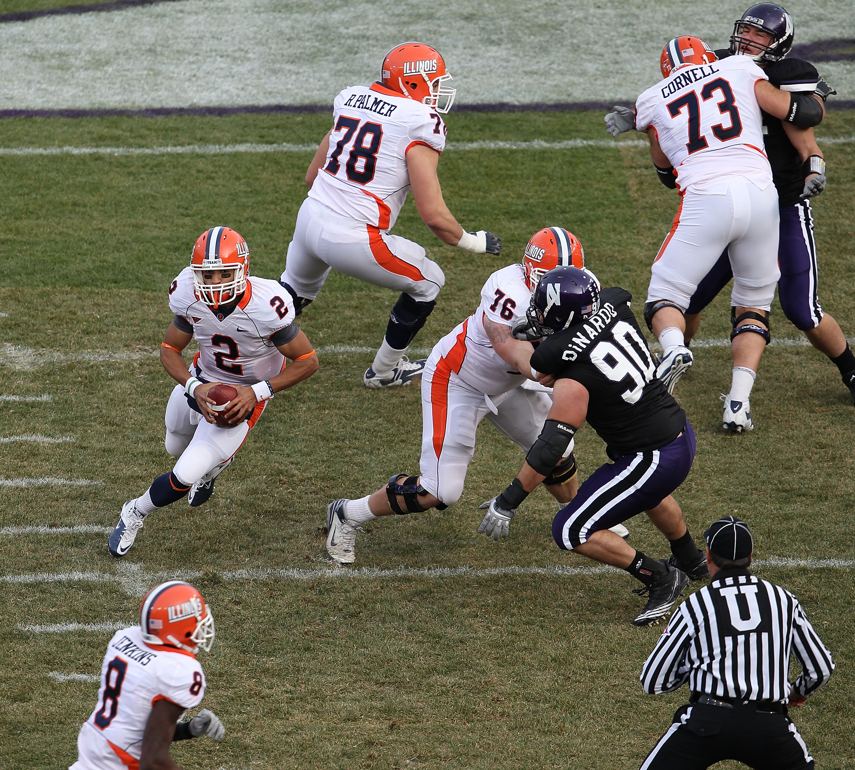 CHICAGO, IL - NOVEMBER 20:  Nathan Scheelhasse #2 of the Illinois Fighting Illini runs as Jack DiNardo #90 of the Northwestern Wildcats rushes during a game played at Wrigley Field on November 20, 2010 in Chicago, Illinois. Illinois defeated Northwestern