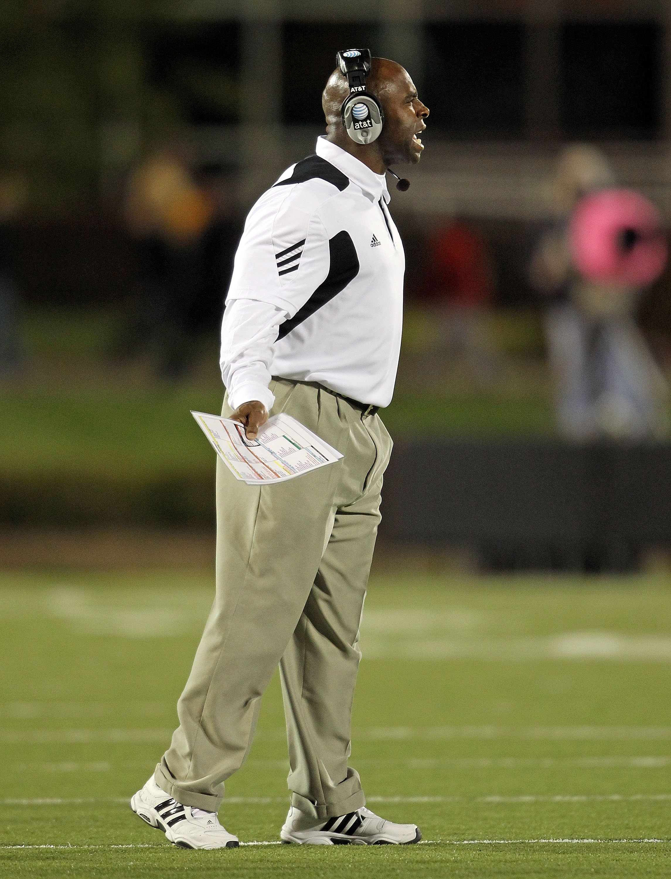 LOUISVILLE, KY - OCTOBER 15: Charlie Strong the Haed Coach of the Louisville Cardinals gives instructions to his team during the Big East Conference game against the Cincinnati Bearcats at Papa John's Cardinal Stadium on October 15, 2010 in Louisville, Ke