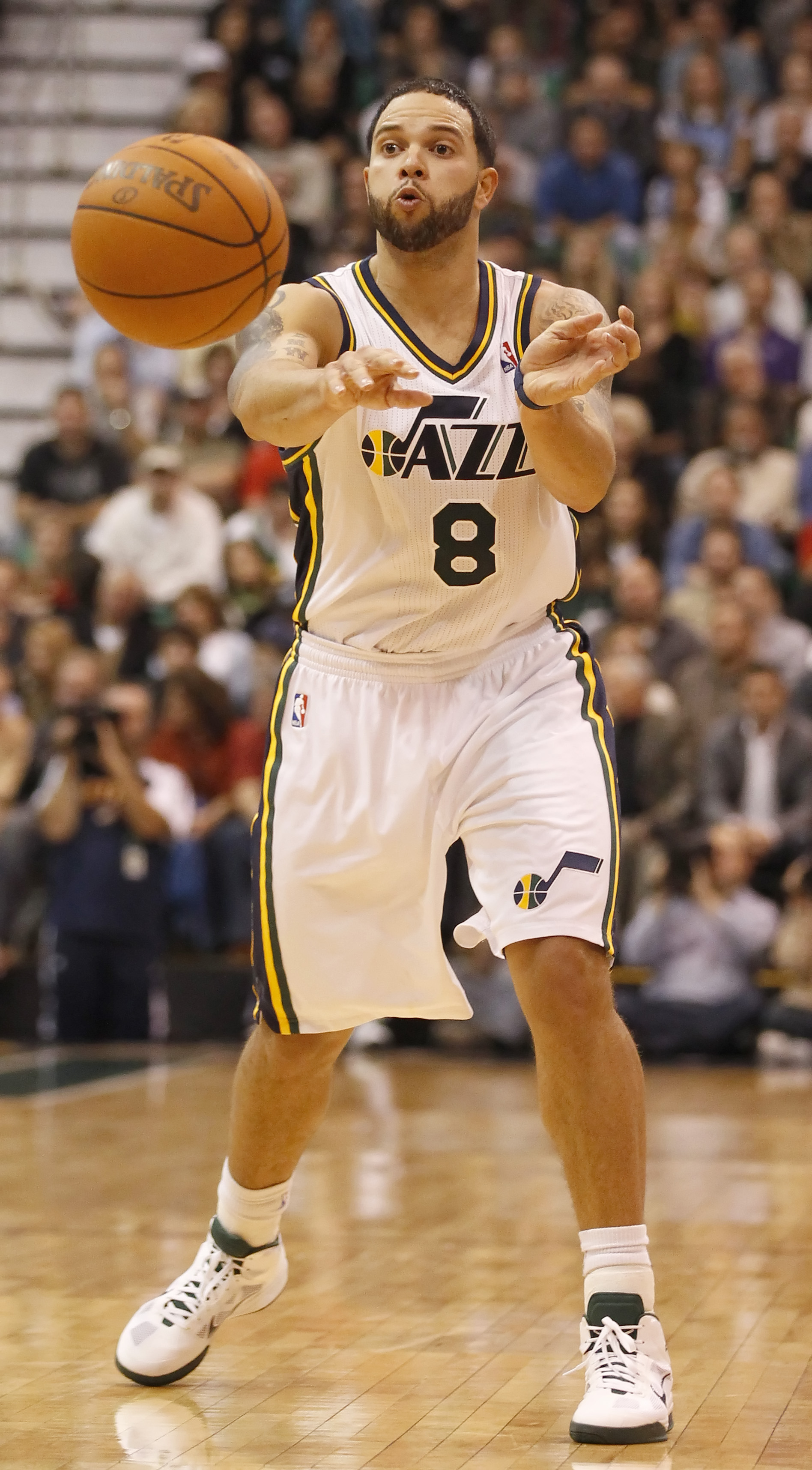 SALT LAKE CITY, UT - DECEMBER 8:  Deron Williams #8 of the Utah Jazz passes the ball during a game against the Miami Heat during the second half of an NBA game December 8, 2010 at Energy Solutions Arena in Salt Lake City, Utah. The Heat beat the Jazz 111-