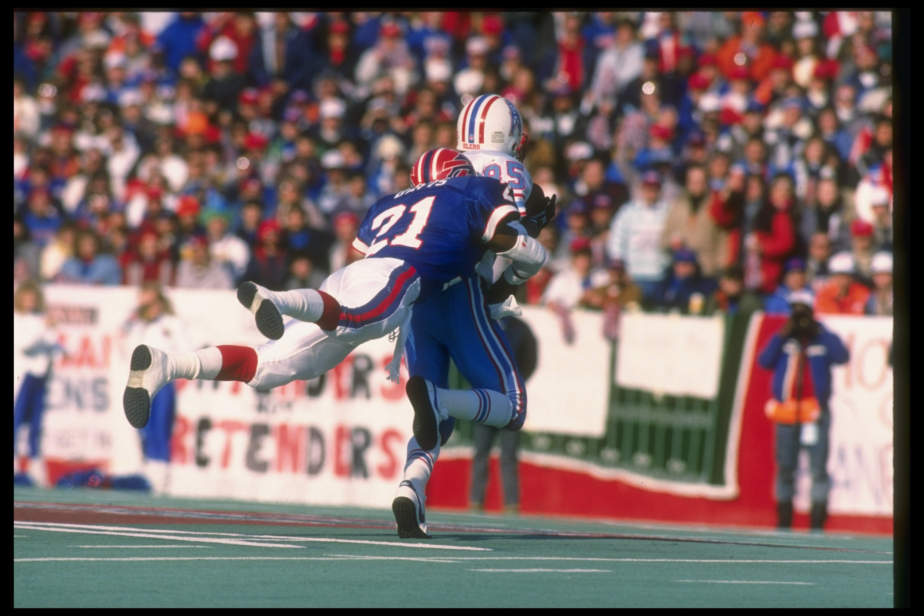 1 Jan 1989:  Defensive back Wayne Davis of the Buffalo Bills (left) tackles Houston Oilers wide receiver Drew Hill during a playoff game at Rich Stadium in Orchard Park, New York.  The Bills won the game, 17-10. Mandatory Credit: Rick Stewart  /Allsport