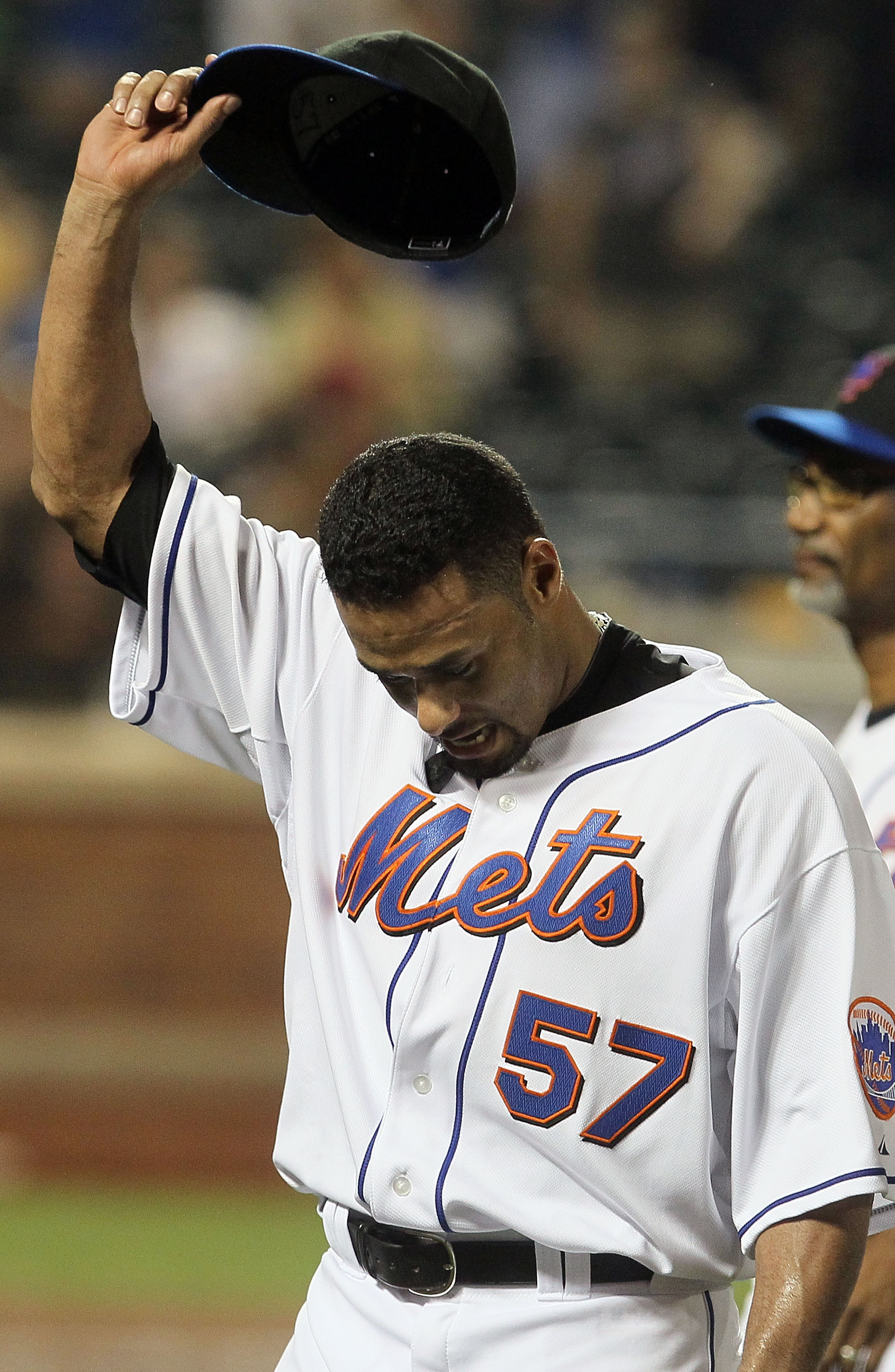 NEW YORK - JULY 06:  Johan Santana #57 of the New York Mets salutes the crowd as he walks off the field after pitching a shutout against the Cincinnati Reds on July 6, 2010 at Citi Field in the Flushing neighborhood of the Queens borough of New York City.
