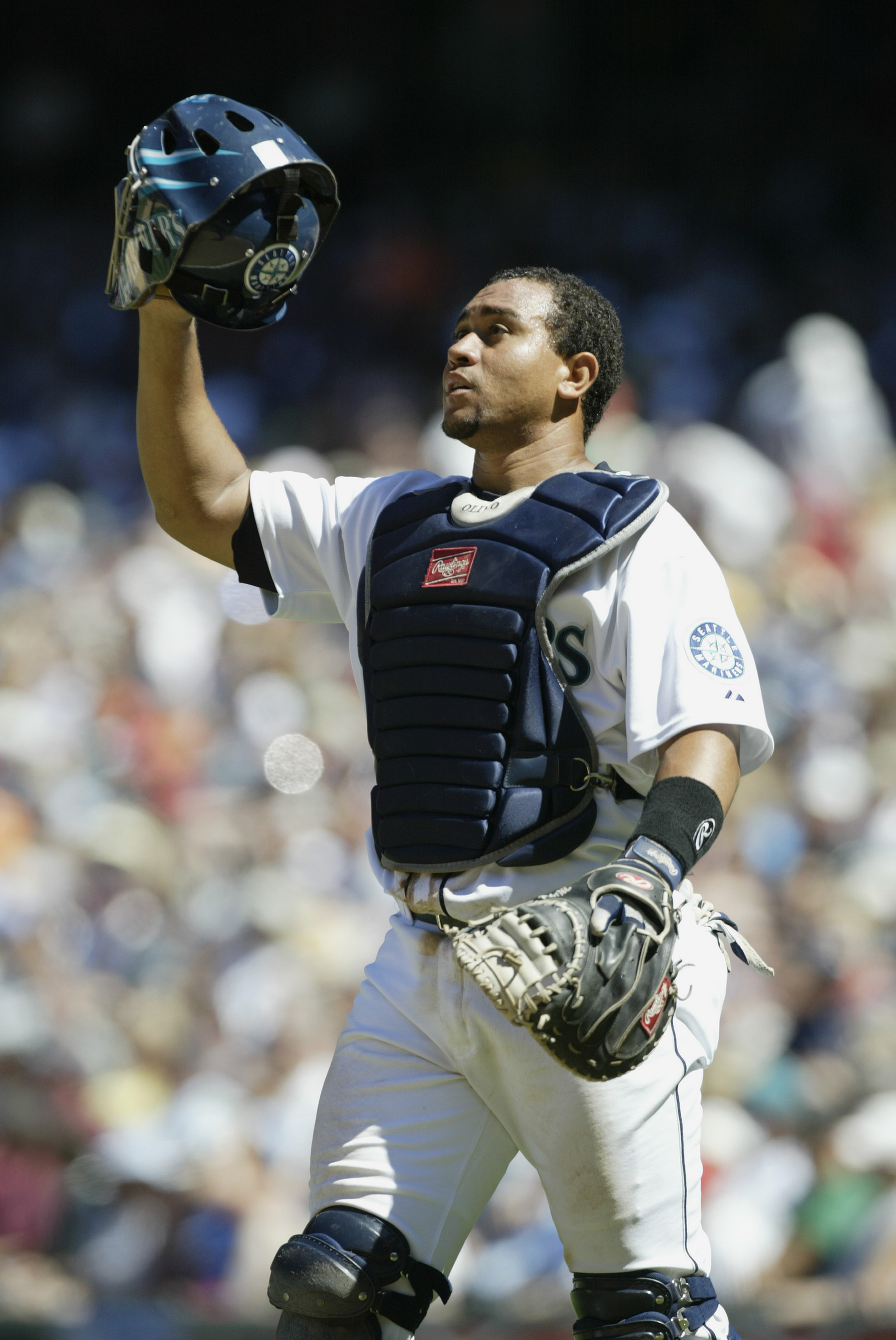SEATTLE - JULY 17:  Catcher Miguel Olivo #8 of the Seattle Mariners adjusts his mask against the Baltimore Orioles during the MLB game on July 17, 2005 at Safeco Field in Seattle Washington. The Mariners defeated the Orioles 8-2.  (Photo by Otto Greule Jr