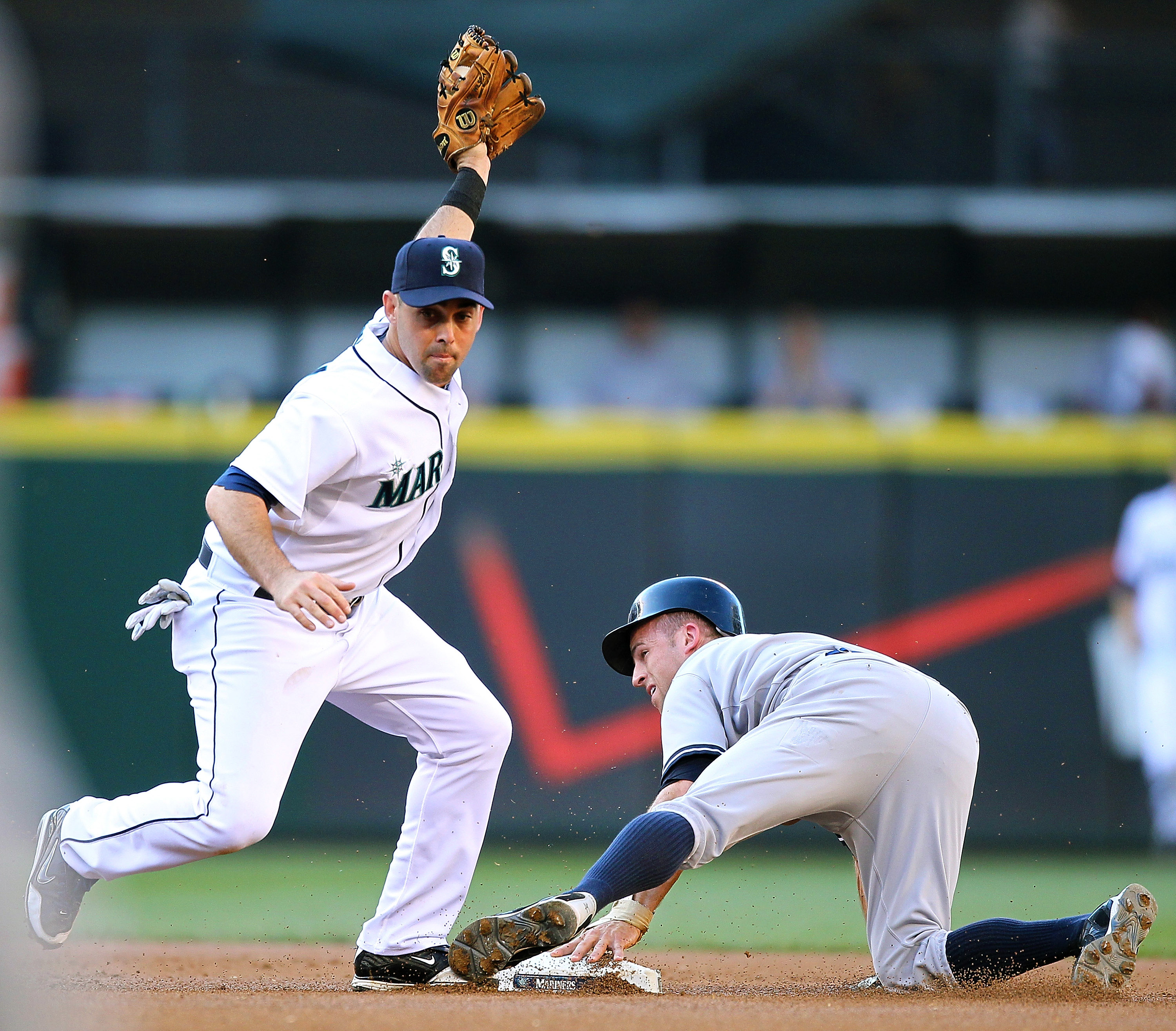 SEATTLE - JULY 10:  Brett Gardner #11 of the New York Yankees is tagged out at second base on a steal attempt by Jack Wilson #2 of the Seattle Mariners at Safeco Field on July 10, 2010 in Seattle, Washington. (Photo by Otto Greule Jr/Getty Images)