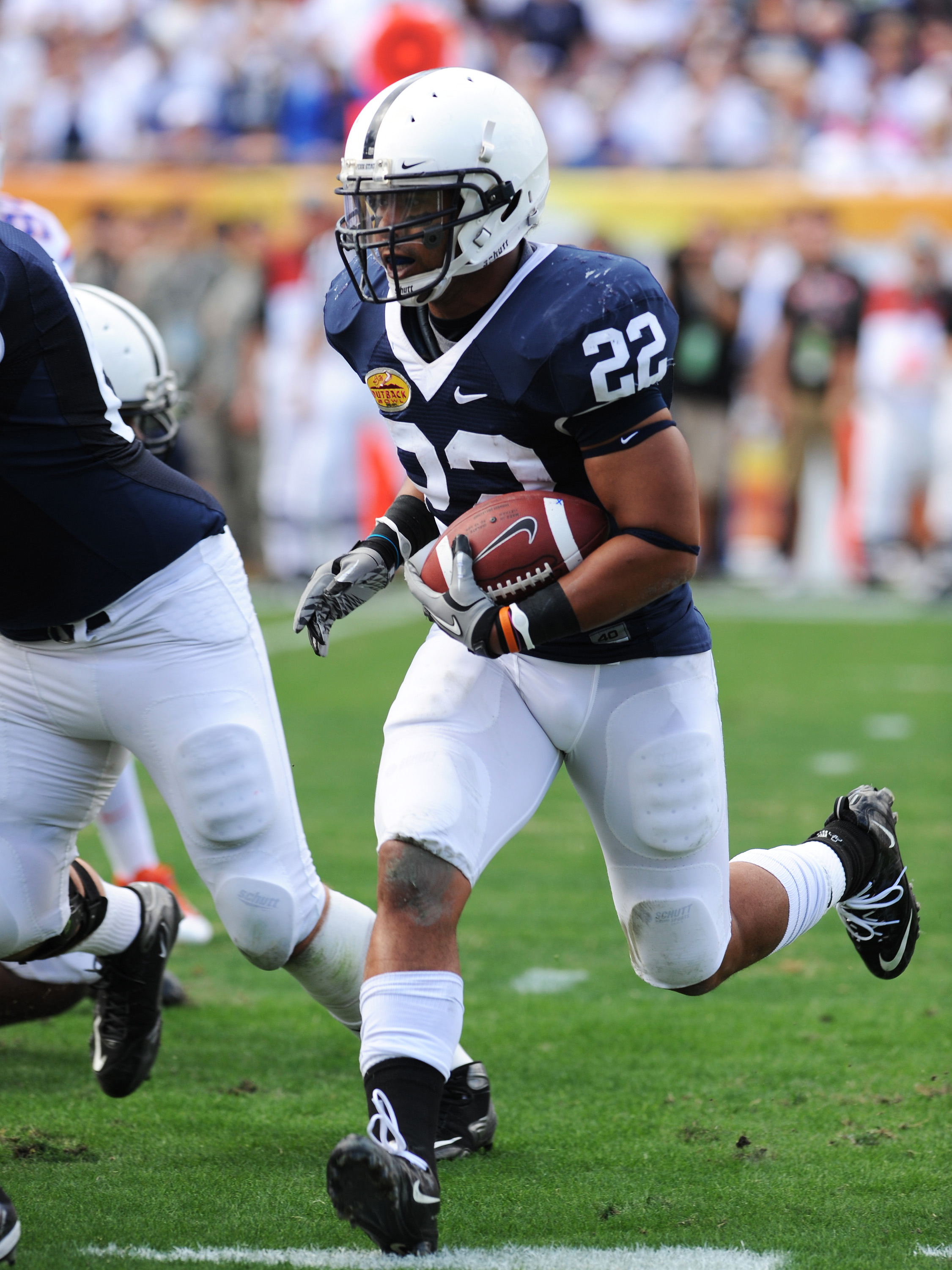 TAMPA, FL - JANUARY 1:  Running back Evan Royster #22 of the Penn State Nittany Lions rushes upfield against the Florida Gators January 1, 2010 in the 25th Outback Bowl at Raymond James Stadium in Tampa, Florida.  (Photo by Al Messerschmidt/Getty Images)