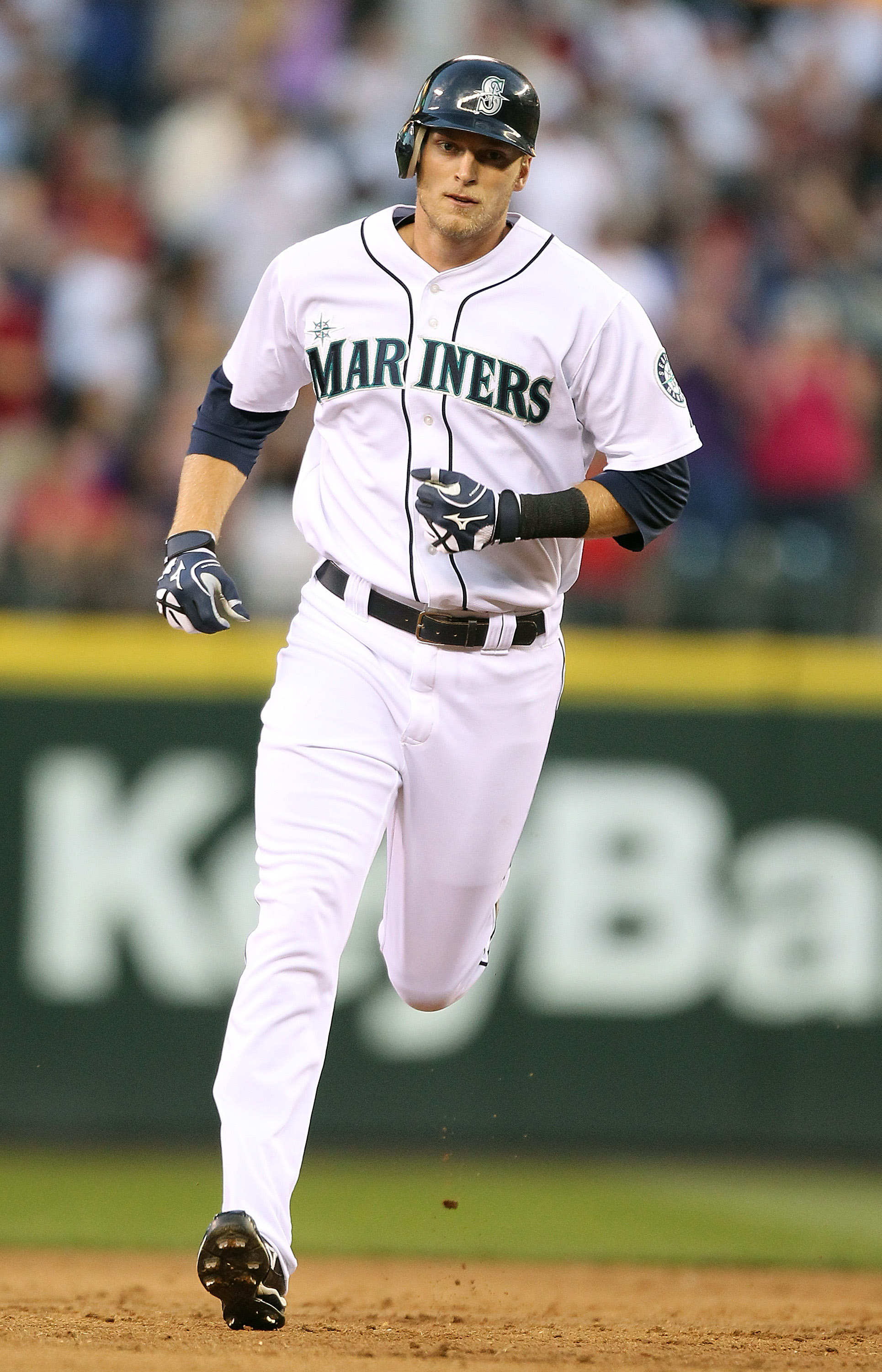 SEATTLE - JULY 24:  Michael Saunders #55 of the Seattle Mariners rounds the bases after hitting a two-run home run to break up a no-hitter in the sixth inning against the Boston Red Sox at Safeco Field on July 24, 2010 in Seattle, Washington. (Photo by Ot