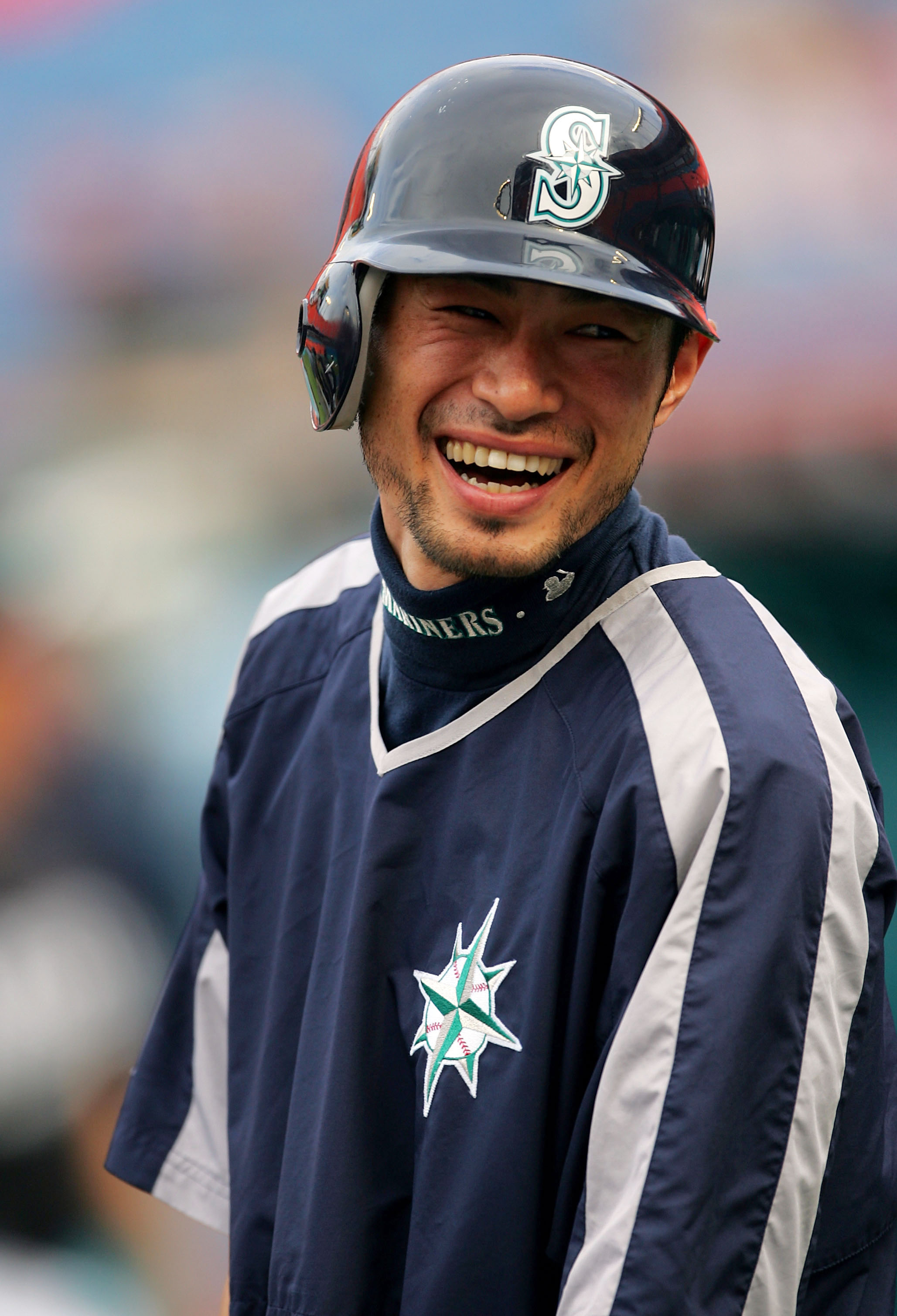 MIAMI - JUNE 8:  Ichiro Suzuki #51 of the Seattle Mariners laughs at a joke during batting practice prior to the game between the Seattle Mariners and the Florida Marlins on June 8, 2005 at Dolphin Stadium in Miami, Florida.  (Photo By Jamie Squire/Getty