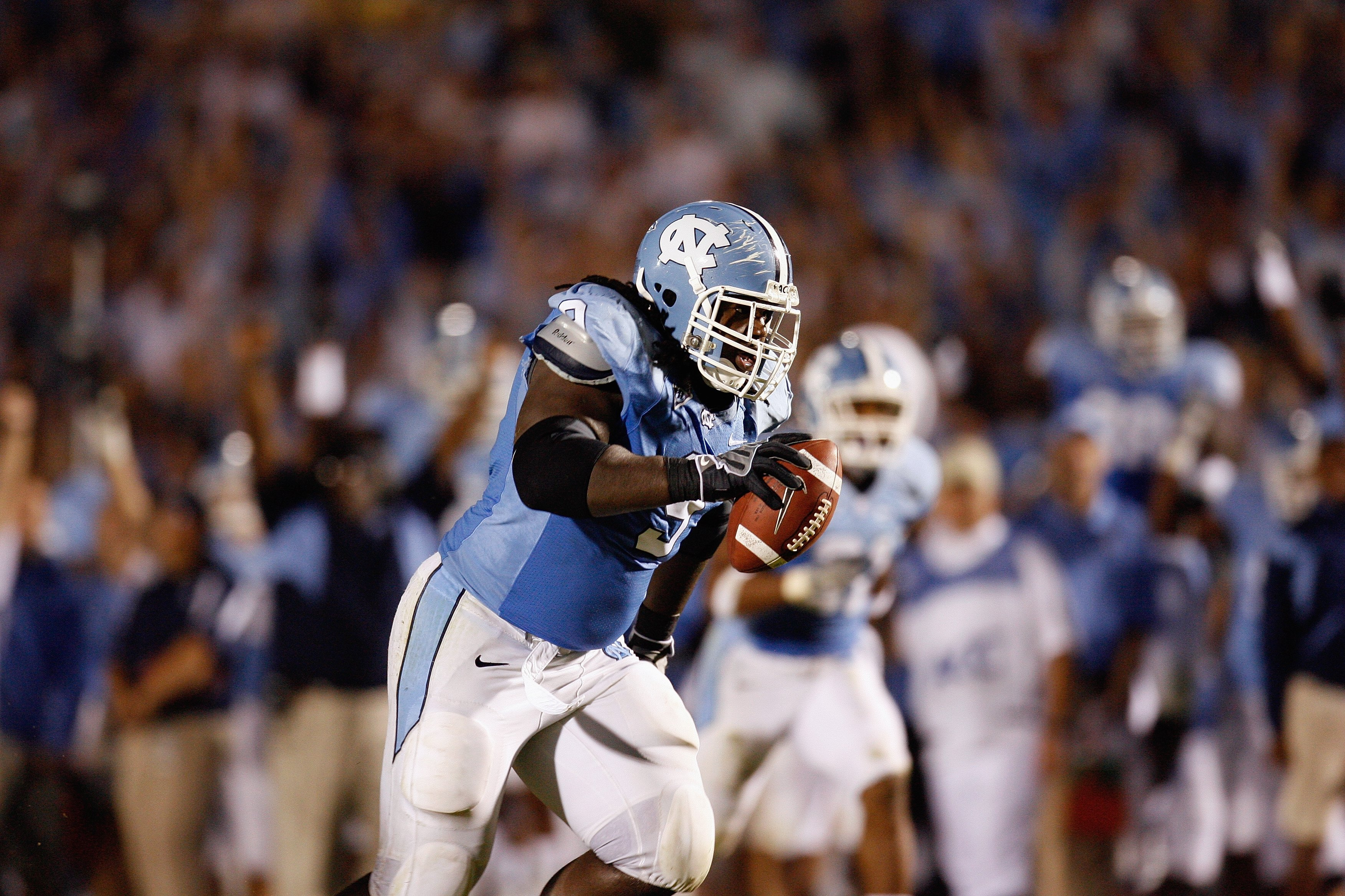 CHAPEL HILL, NC - OCTOBER 4:  Marvin Austin #9 of the North Carolina Tar Heels returns an interception for a touchdown during the game against the Connecticut Huskies at Kenan Stadium on October 4, 2008 in Chapel Hill, North Carolina.  (Photo by Kevin C.