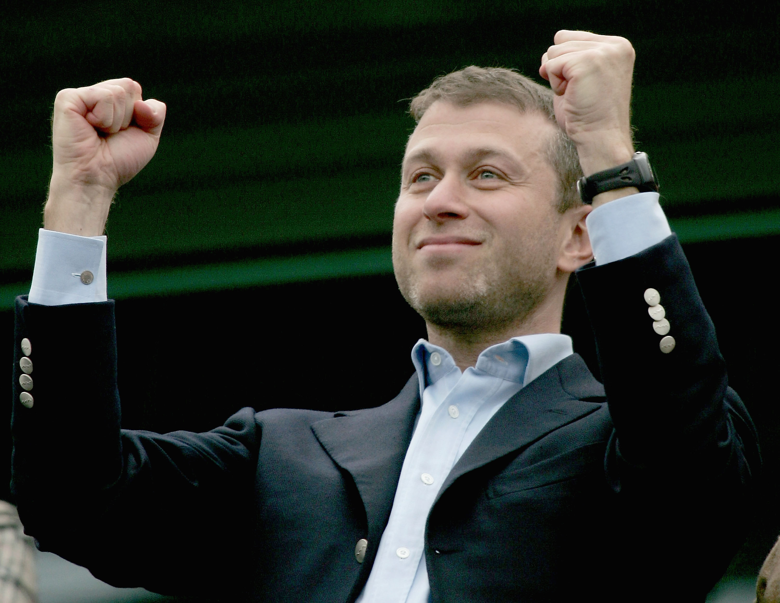 LONDON - APRIL 23:  Chelsea Owner, Roman Abramovic salutes his players after winning the Barclays Premiership match between Chelsea and Fulham 3-1 at Stamford Bridge on April 23, 2005 in London, England.  (Photo by Ben Radford/Getty Images)