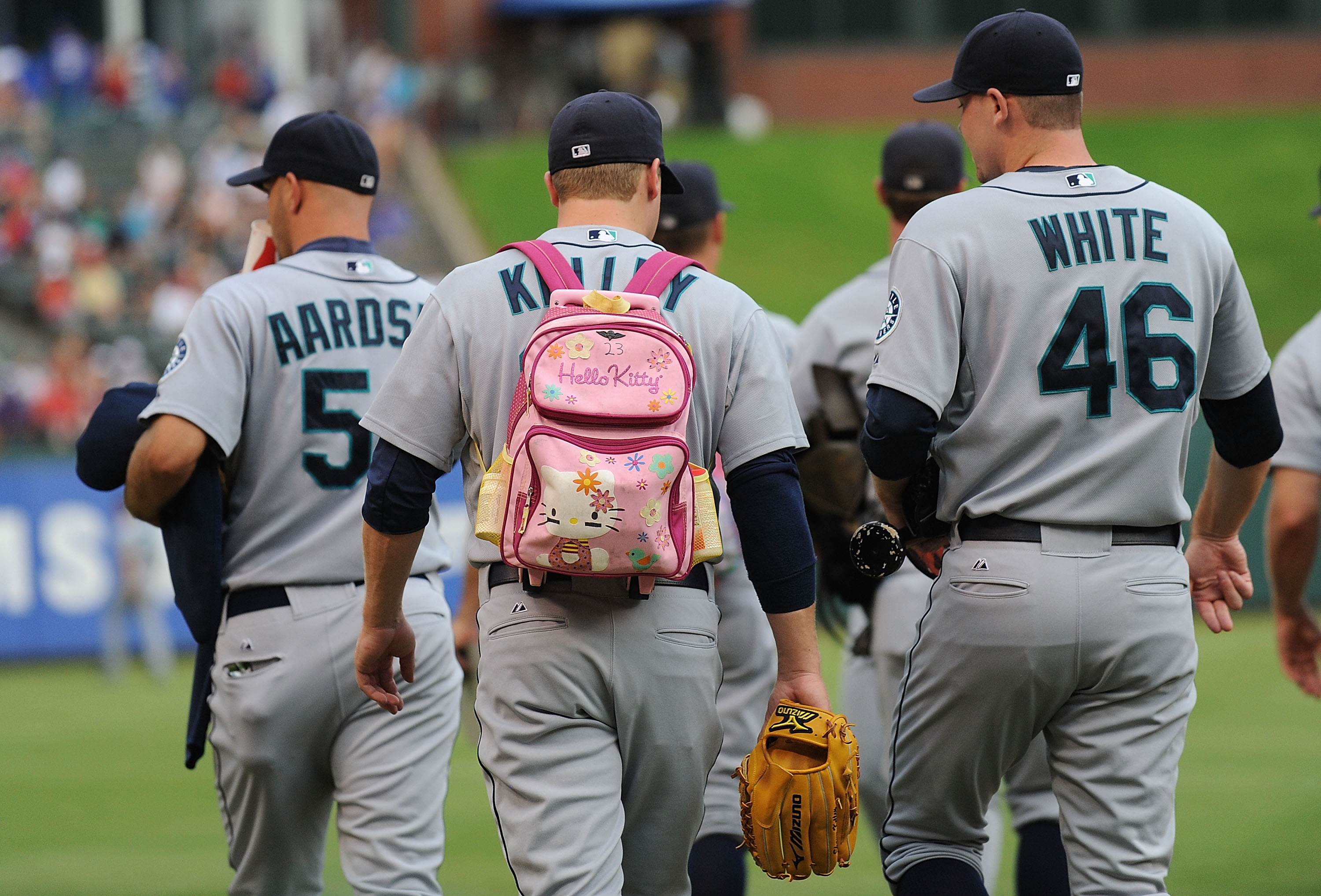 ARLINGTON, TX - JULY 31:  Rookie pitcher Shawn Kelley #23 of the Seattle Mariners walks to the bullpen while wearing a 'Hello Kitty' backpack before a game with the Texas Rangers on July 31, 2009 at Rangers Ballpark in Arlington, Texas.  (Photo by Ronald