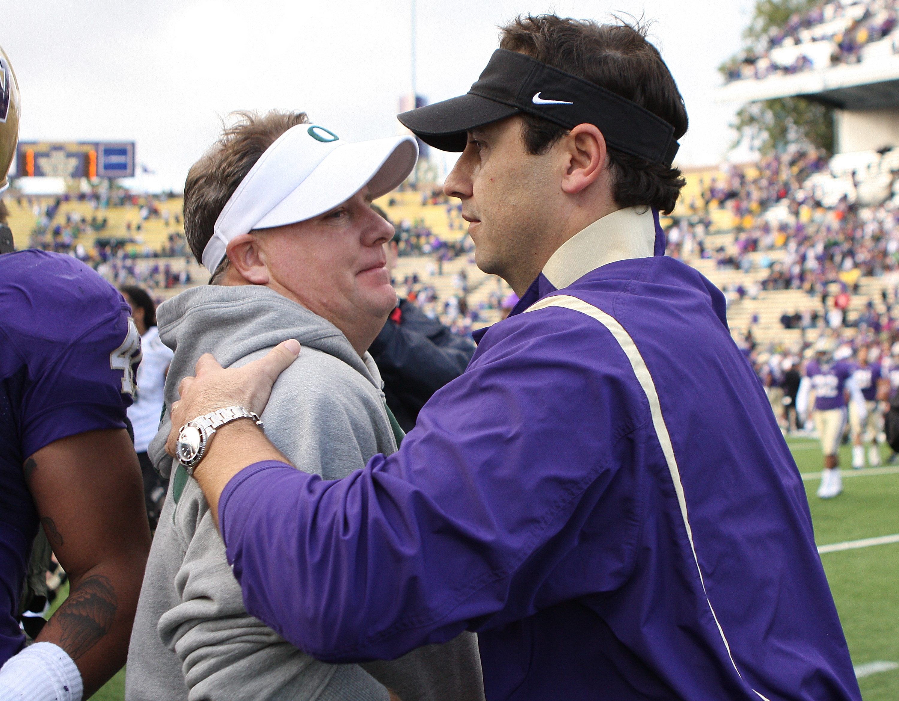 SEATTLE - OCTOBER 24:  Head coach Steve Sarkisian (R) of the Washington Huskies congratulates head coach Chip Kelly of the Oregon Ducks after the game on October 24, 2009 at Husky Stadium in Seattle, Washington. The Ducks defeated the Huskies 43-19. (Phot