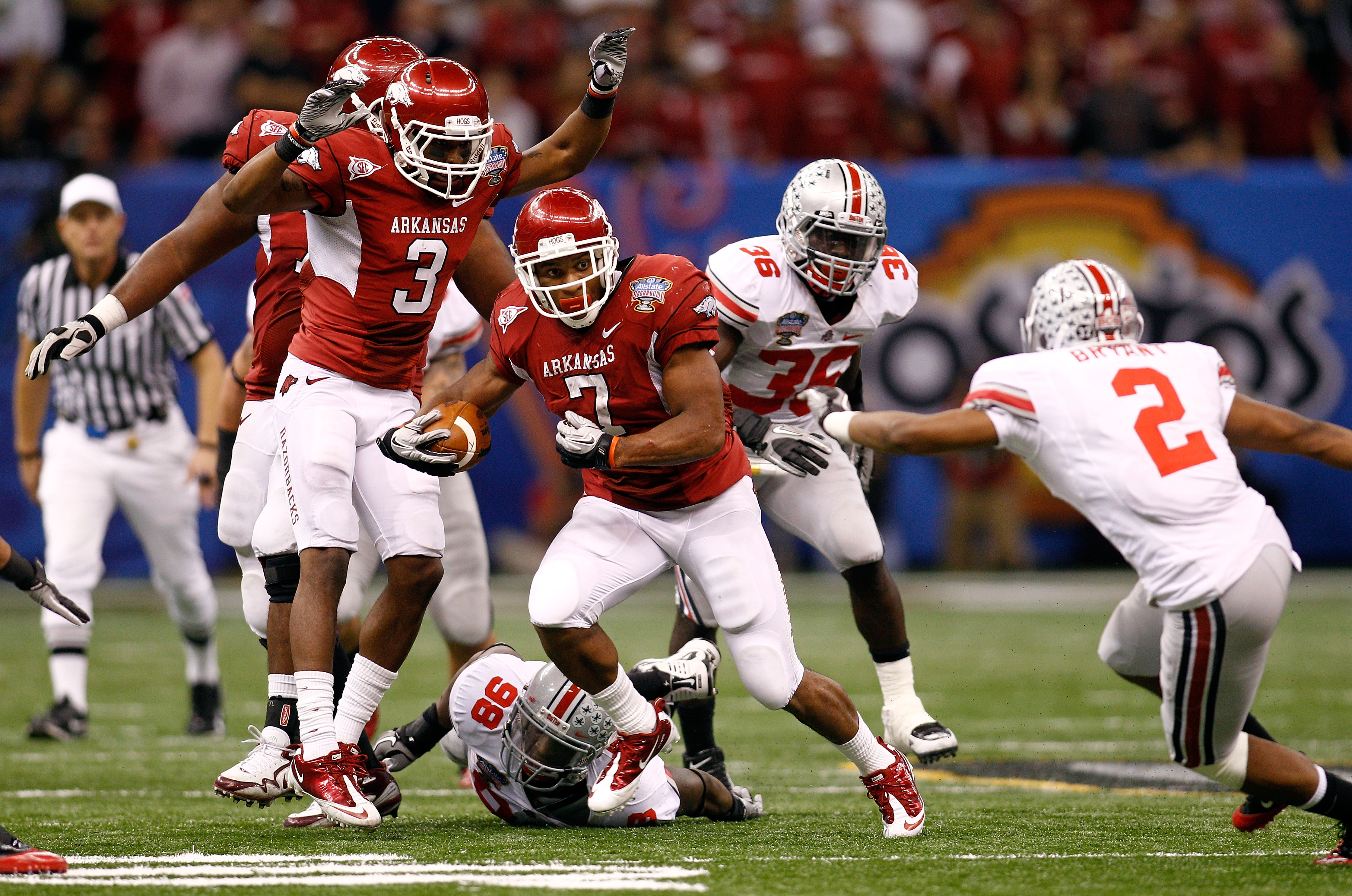 NEW ORLEANS, LA - JANUARY 04:  Knile Davis #7 of the Arkansas Razorbacks runs the ball in the second half against the Ohio State Buckeyes during the Allstate Sugar Bowl at the Louisiana Superdome on January 4, 2011 in New Orleans, Louisiana.  (Photo by Ch